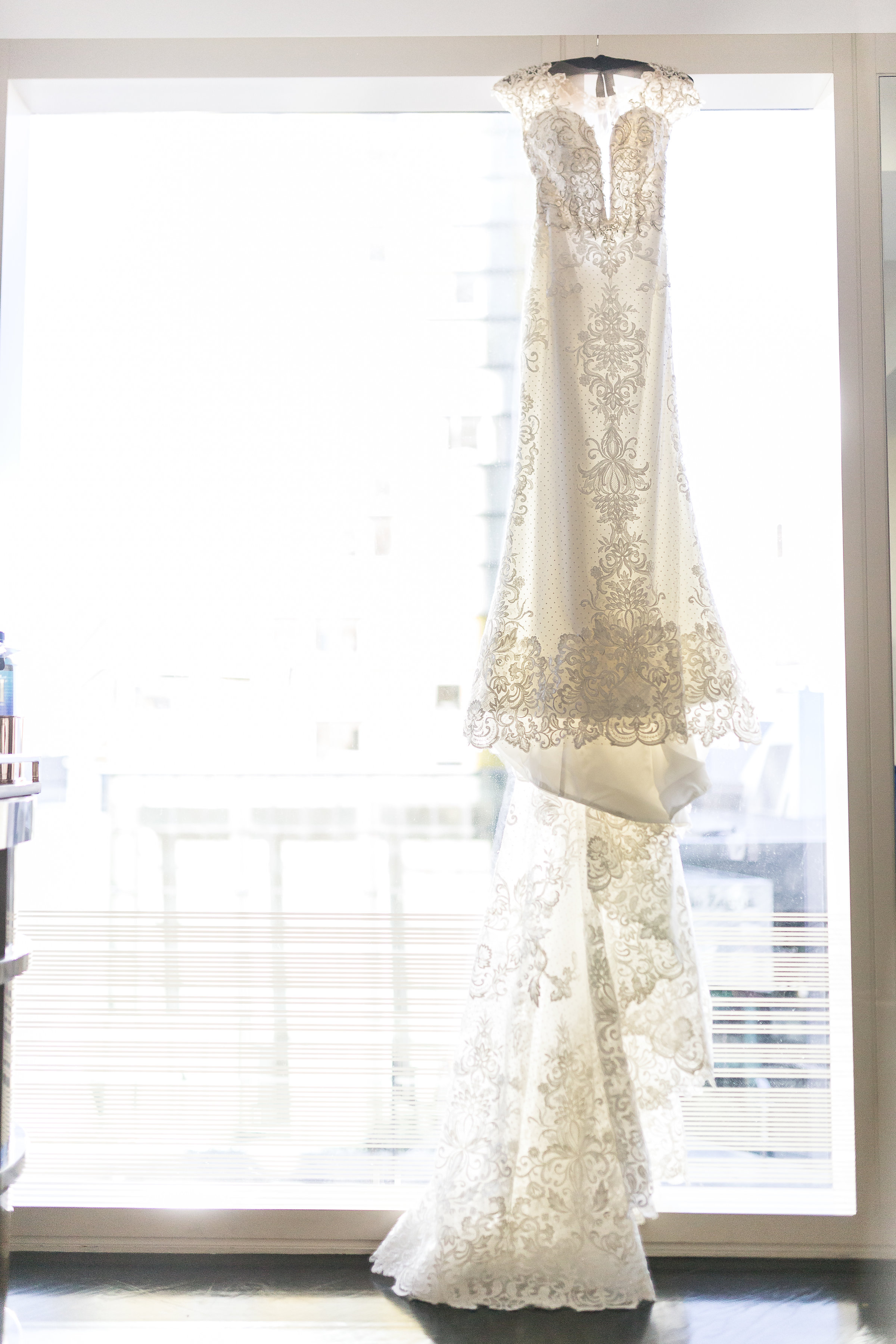 lace wedding dress.Wedding Planner: Andrea Eppolito Events    Photography  Brian Leahy    Videography  HOO Films    Venue & Catering:  Mandarin Oriental  / Waldorf Astoria   Floral & Decor: Destinations by Design    Lighting: LED Unplugged    Music:  DJ Breeze II    Hair & Make Up: Amelia C & Co