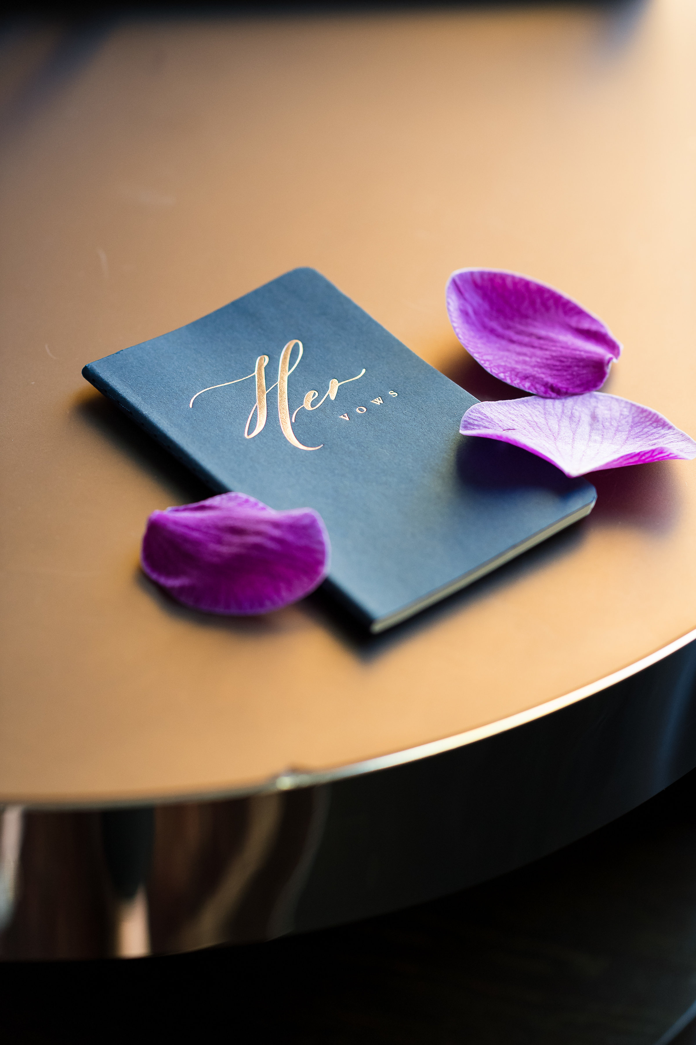 Vow Books.Wedding Planner: Andrea Eppolito Events    Photography  Brian Leahy    Videography  HOO Films    Venue & Catering:  Mandarin Oriental  / Waldorf Astoria   Floral & Decor: Destinations by Design    Lighting: LED Unplugged    Music:  DJ Breeze II    Hair & Make Up: Amelia C & Co
