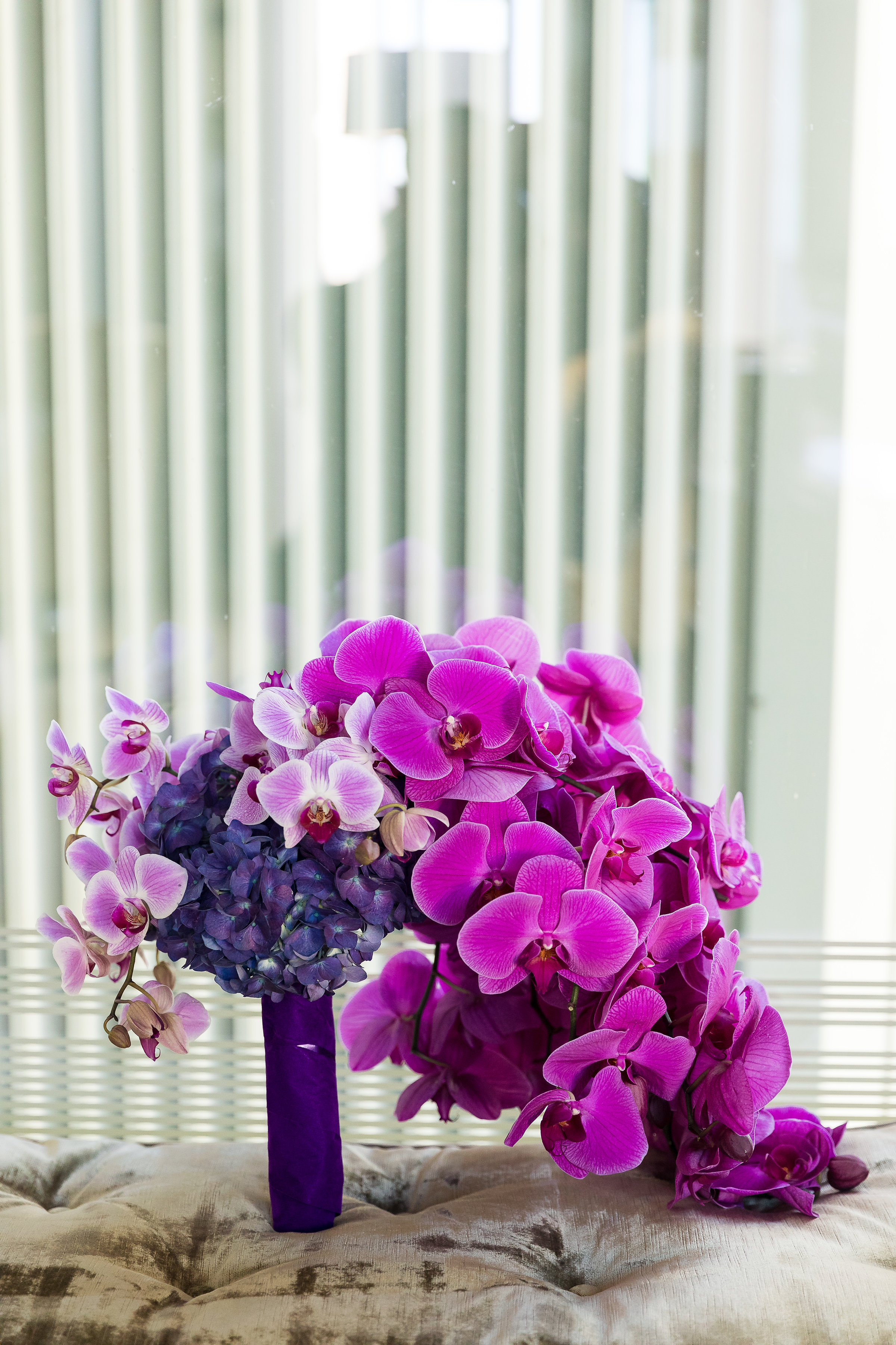 Purple and fuchsia bridal bouquet. Wedding Planner: Andrea Eppolito Events    Photography  Brian Leahy    Videography  HOO Films    Venue & Catering:  Mandarin Oriental  / Waldorf Astoria   Floral & Decor: Destinations by Design    Lighting: LED Unplugged    Music:  DJ Breeze II    Hair & Make Up: Amelia C & Co
