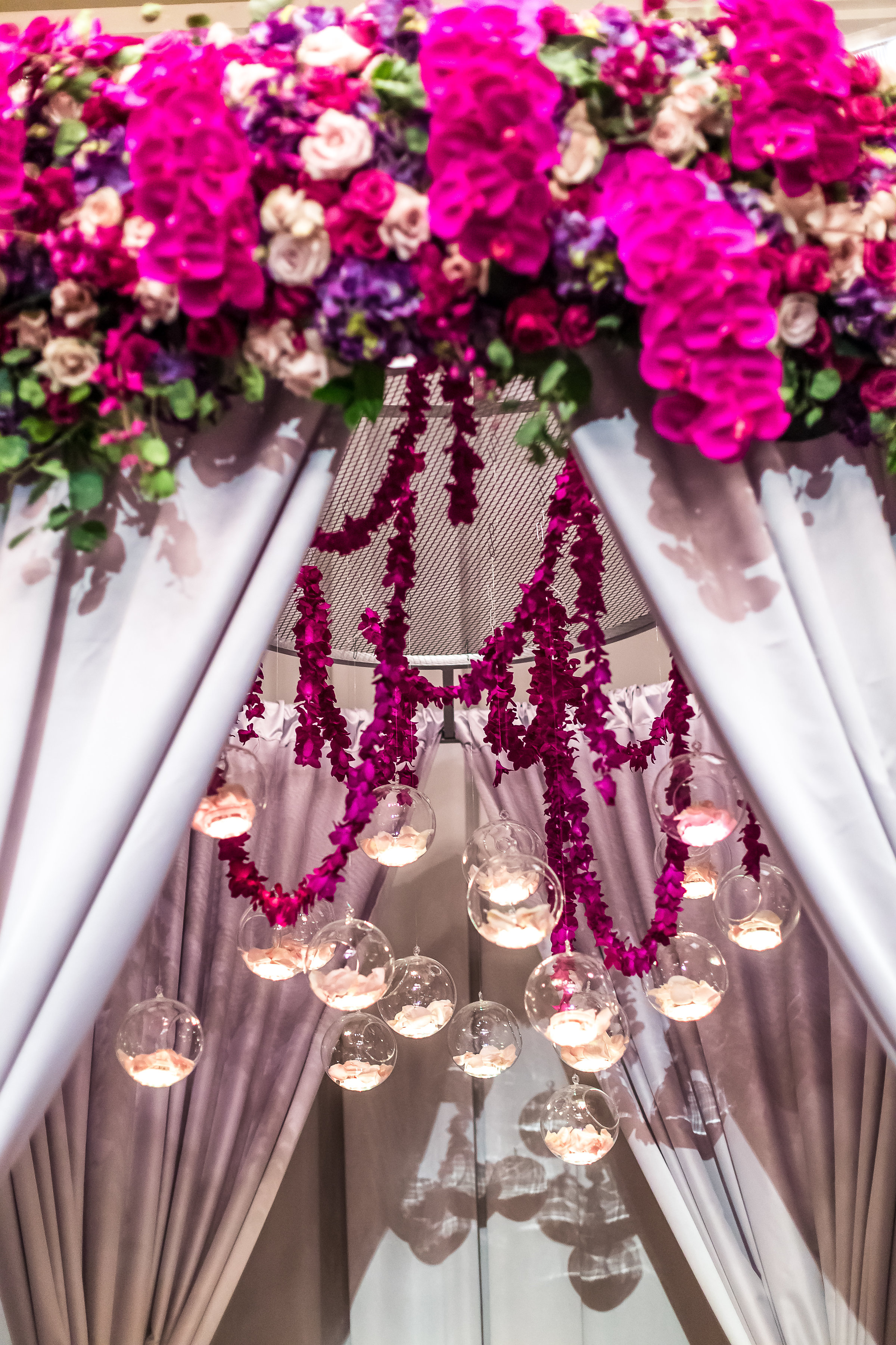 Wedding gazebo treatment with hanging lights and orchids.Wedding Planner: Andrea Eppolito Events    Photography  Brian Leahy    Videography  HOO Films    Venue & Catering:  Mandarin Oriental  / Waldorf Astoria   Floral & Decor: Destinations by Design    Lighting: LED Unplugged    Music:  DJ Breeze II    Hair & Make Up: Amelia C & Co