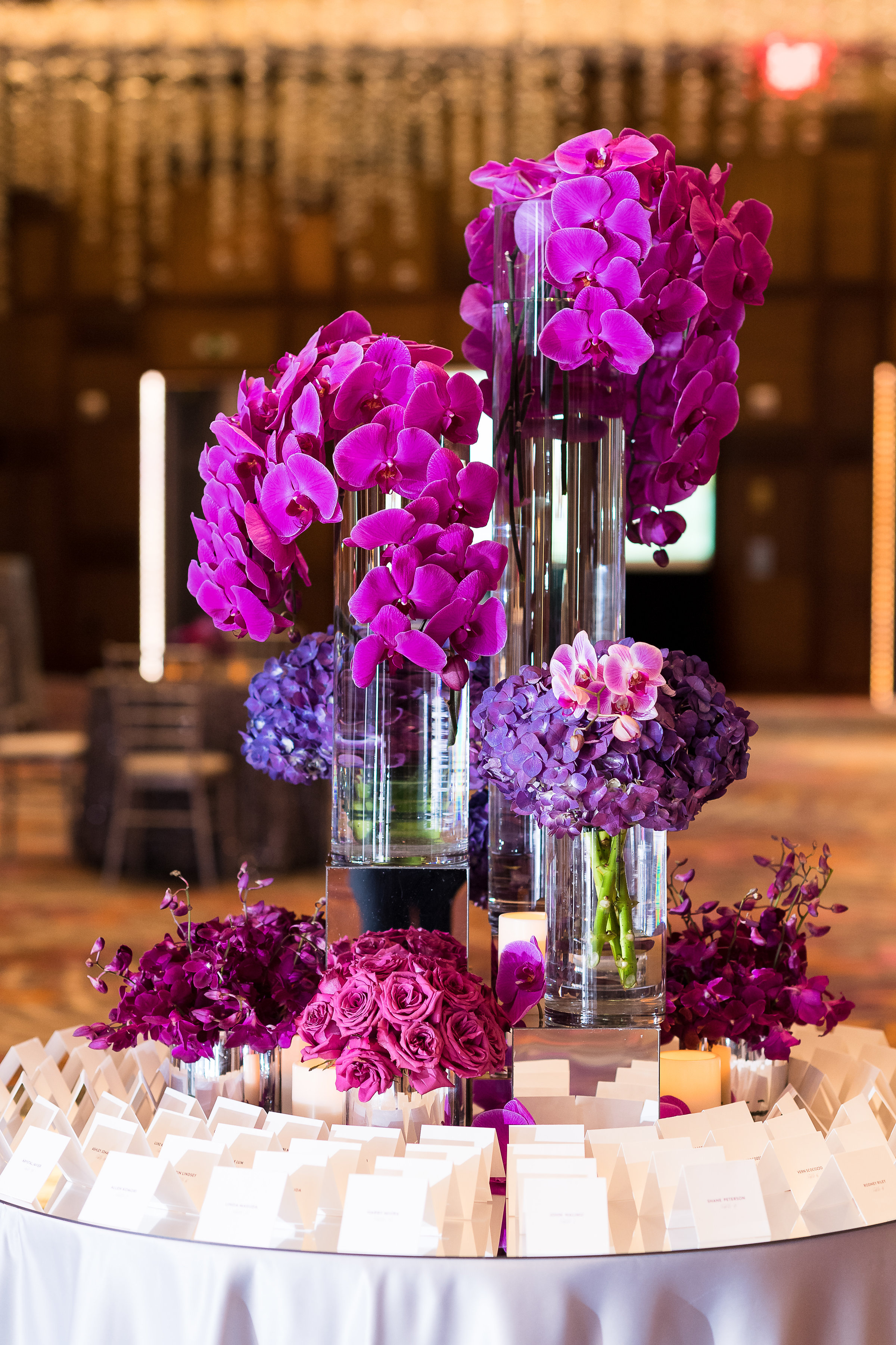 Escort card table with purple orchids