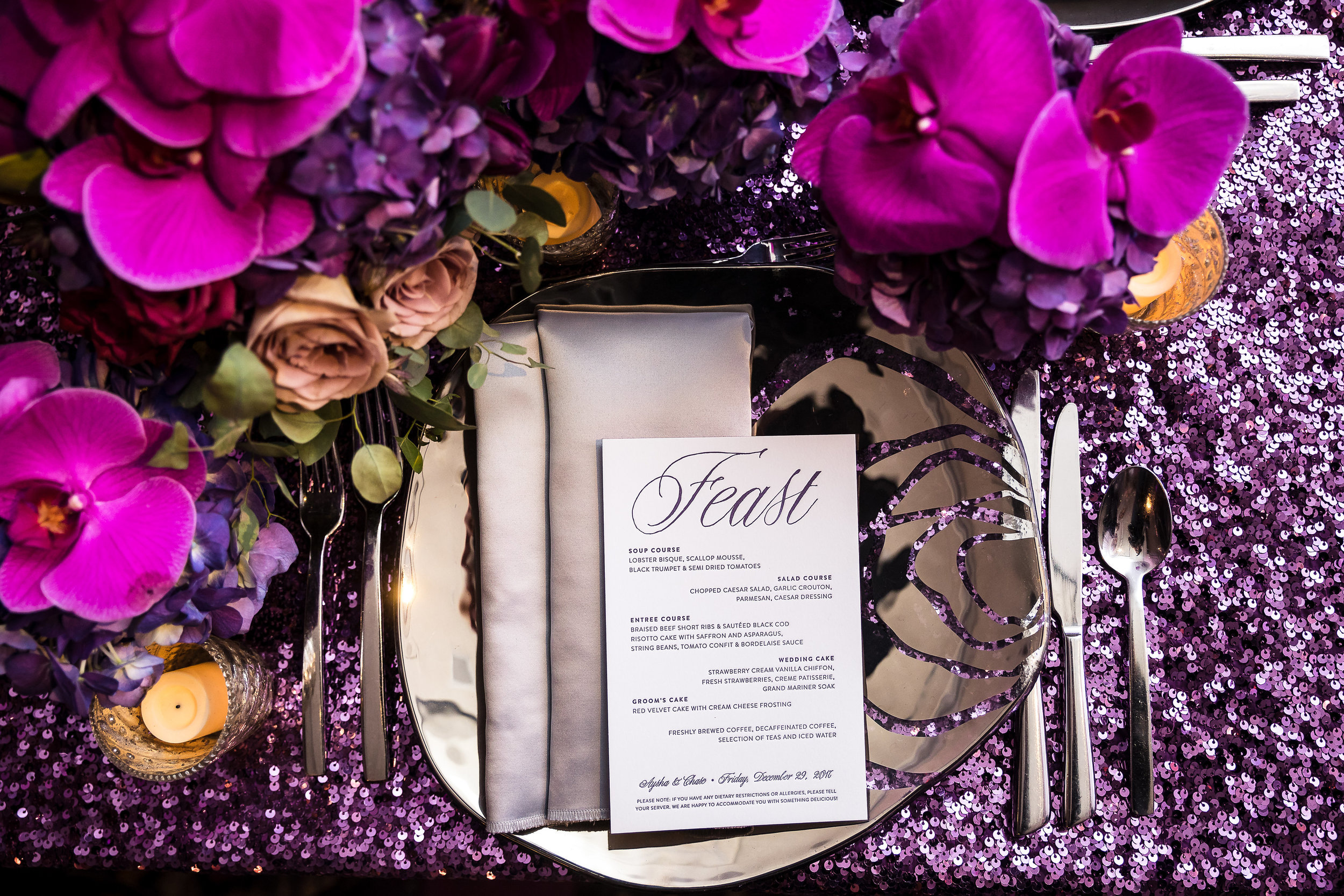 FEAST! Letterpress menu with grey and purple print.Wedding Planner: Andrea Eppolito Events    Photography  Brian Leahy    Videography  HOO Films    Venue & Catering: Mandarin Oriental / Waldorf Astoria   Floral & Decor: Destinations by Design    Lighting: LED Unplugged    Music: DJ Breeze II    Hair & Make Up: Amelia C & Co    Invitations by  Bliss & Bone    Menu and Escort Cards by  Meldeen