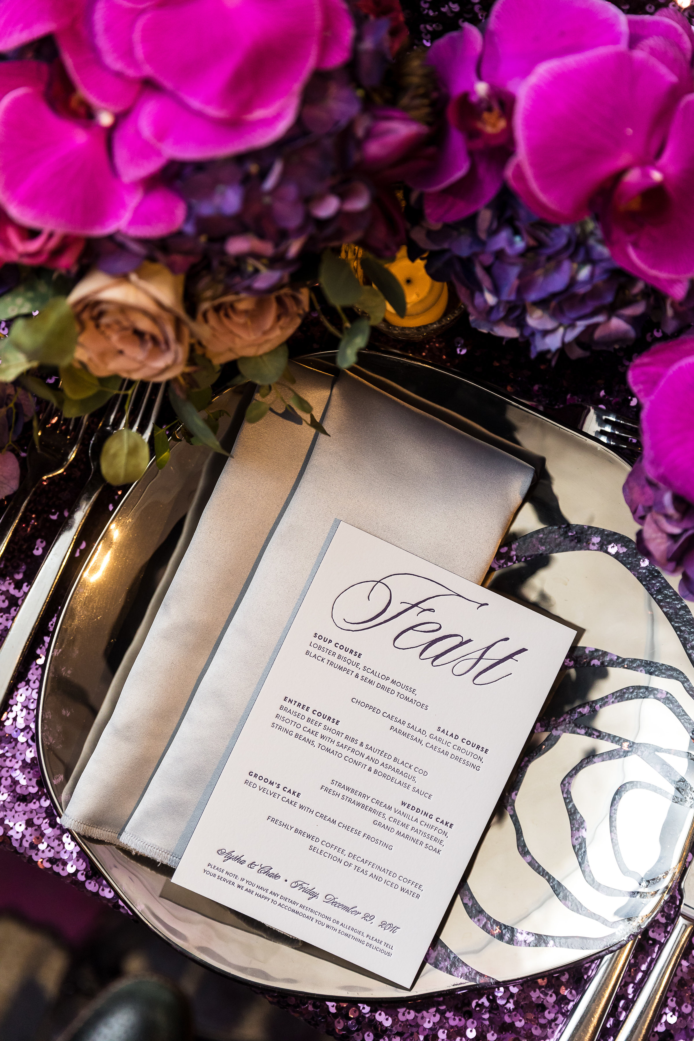 Luxe letterpress menus on purple sequence linens and folder napkin.Wedding Planner: Andrea Eppolito Events    Photography  Brian Leahy    Videography  HOO Films    Venue & Catering: Mandarin Oriental / Waldorf Astoria   Floral & Decor: Destinations by Design    Lighting: LED Unplugged    Music: DJ Breeze II    Hair & Make Up: Amelia C & Co    Invitations by  Bliss & Bone    Menu and Escort Cards by  Meldeen