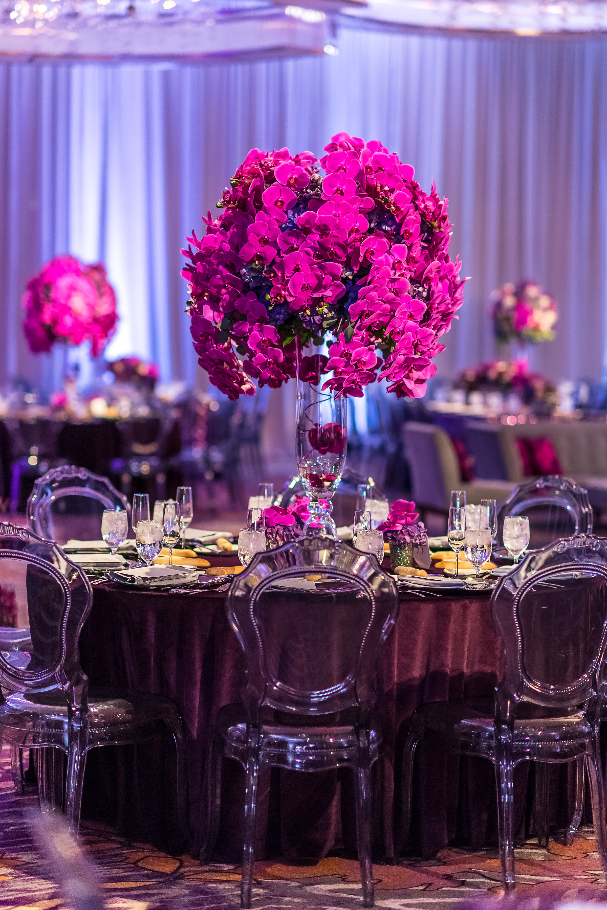 Oh so luxe! Fullo orchid centerpieces.Wedding Planner: Andrea Eppolito Events    Photography  Brian Leahy    Videography  HOO Films    Venue & Catering: Mandarin Oriental / Waldorf Astoria   Floral & Decor: Destinations by Design    Lighting: LED Unplugged    Music: DJ Breeze II    Hair & Make Up: Amelia C & Co    Invitations by  Bliss & Bone    Menu and Escort Cards by  Meldeen