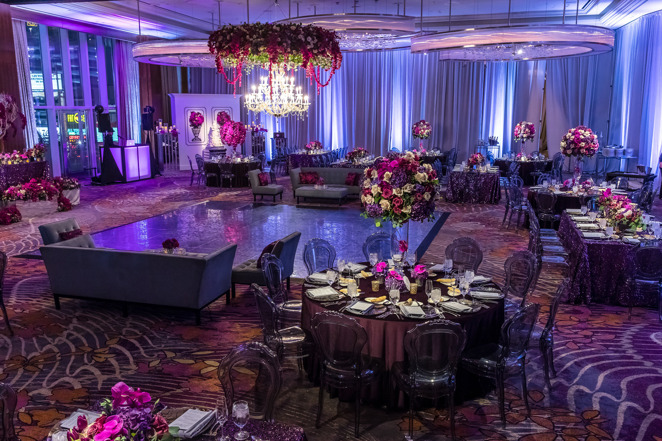 Overview of ballroom at the Mandarin Oriental / Waldorf Astoria. Luxe purple wedding at the Mandarin Oriental.Wedding Planner: Andrea Eppolito Events    Photography  Brian Leahy    Videography  HOO Films    Venue & Catering:  Mandarin Oriental  / Waldorf Astoria   Floral & Decor: Destinations by Design    Lighting: LED Unplugged    Music:  DJ Breeze II    Hair & Make Up: Amelia C & Co    Invitations by  Bliss & Bone    Menu and Escort Cards by  Meldeen