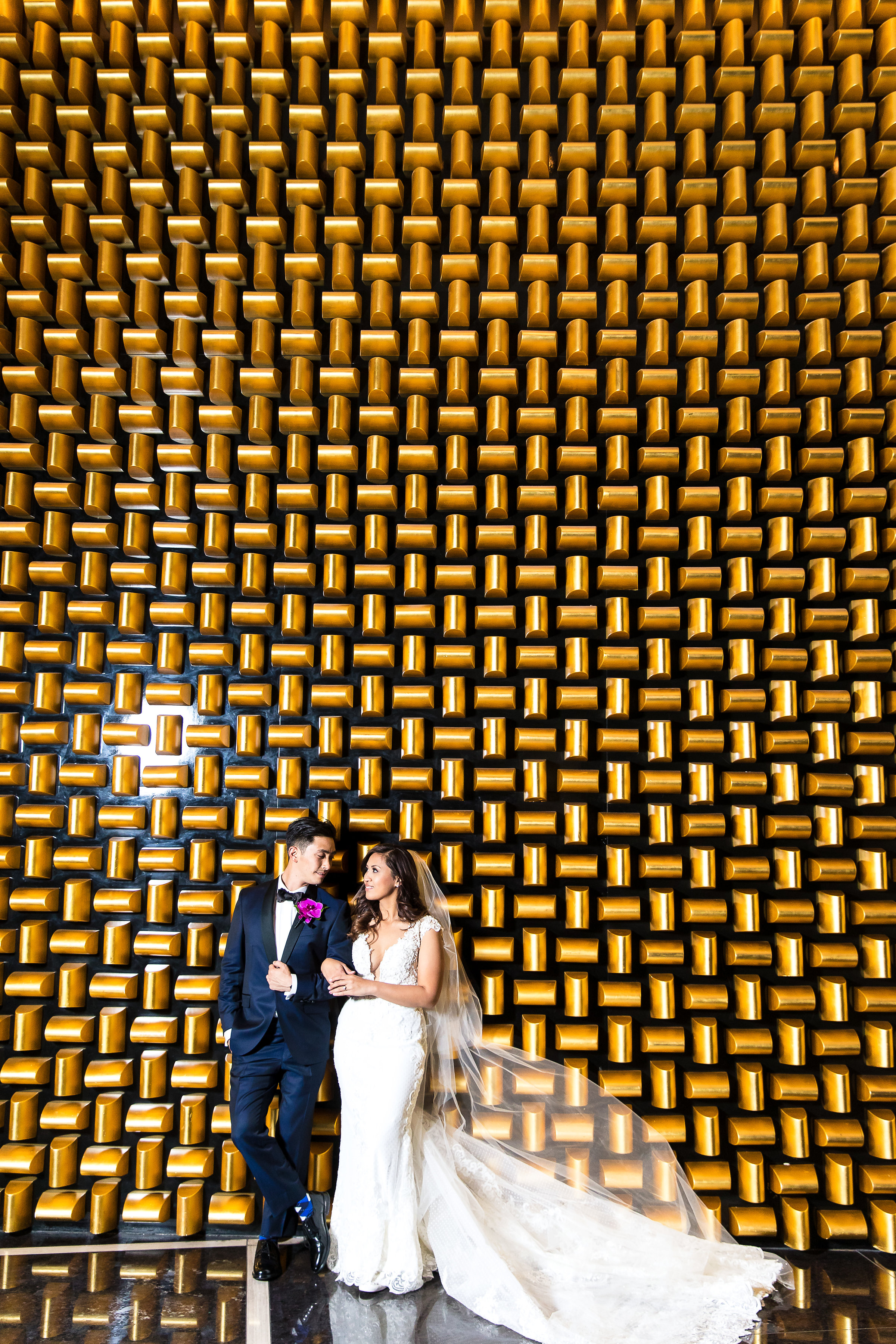 Iconic gold wall at the Mandarin Oriental Las Vegas. Brides and grooms love this as a photo backdrop!  Wedding Planner: Andrea Eppolito Events    Photography  Brian Leahy    Videography  HOO Films    Venue & Catering:  Mandarin Oriental  / Waldorf Astoria   Floral & Decor: Destinations by Design    Lighting: LED Unplugged    Music:  DJ Breeze II    Hair & Make Up: Amelia C & Co    Invitations by  Bliss & Bone    Menu and Escort Cards by  Meldeen