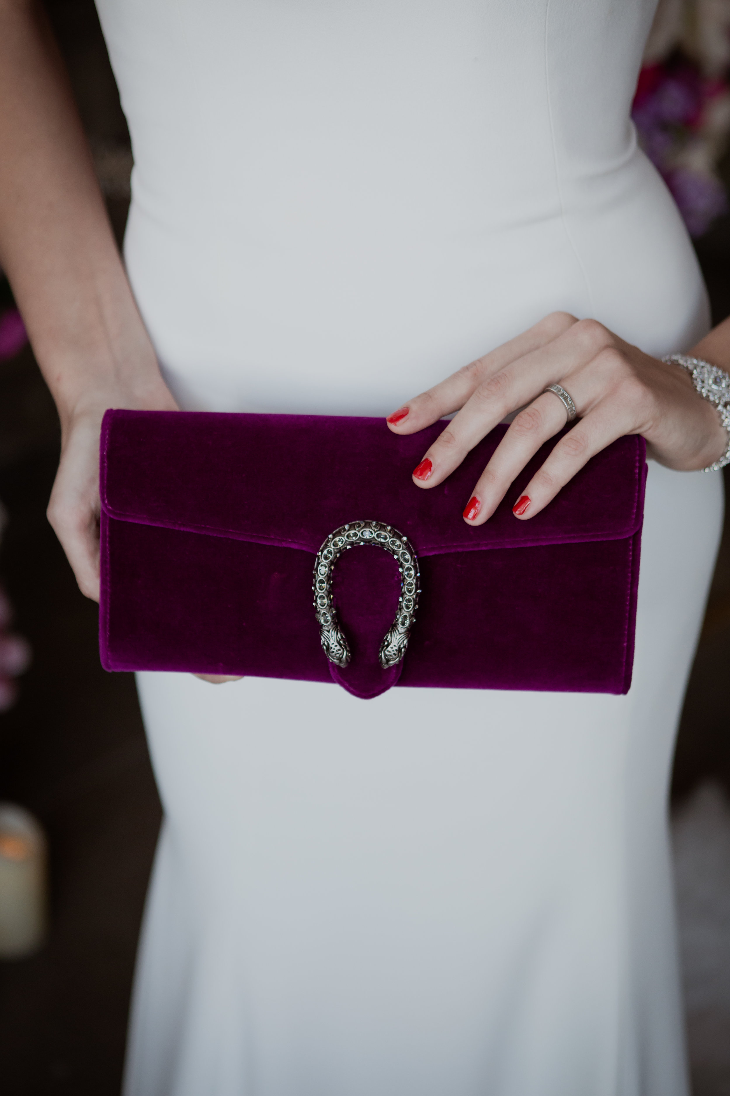 Fuschia Dionysus Velvet Clutch.  Las Vegas Wedding Planner & Event Designer  Andrea Eppolito Events  · Photography by  Adam Frazier Photo  · Video by  M Place Productions  · Floral & Decor by  DBD Las Vegas  · Venue  ARIA Primrose Ballroom  · Cigar Band by  Royal Cigar Company  and  Jason of Beverly Hills  · Beauty by  Glammed Up Las Vegas  · Dress by  Vera Wang  · Salon  Couture Bride Las Vegas  · Shoes  Bella Belle Shoes  · Bride  Katrina May Armenta  · Groom  Lucas Cuevas