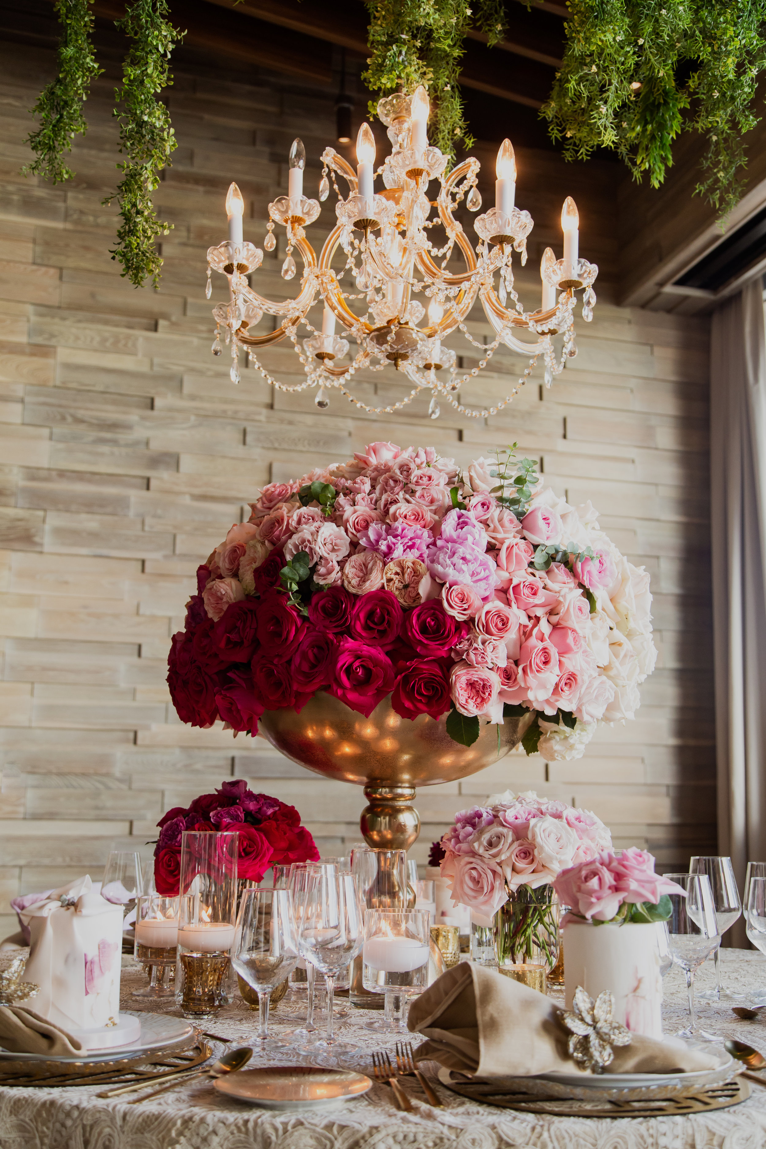 Pink ombre centerpiece on gold lace table cloth. Las Vegas Wedding Planner & Event Designer  Andrea Eppolito Events  · Photography by  Adam Frazier Photo  · Video by  M Place Productions  · Floral & Decor by  DBD Las Vegas  · Venue  ARIA Primrose Ballroom  · Cigar Band by  Royal Cigar Company  and  Jason of Beverly Hills  · Beauty by  Glammed Up Las Vegas  · Dress by  Vera Wang  · Salon  Couture Bride Las Vegas  · Shoes  Bella Belle Shoes  · Bride  Katrina May Armenta  · Groom  Lucas Cuevas