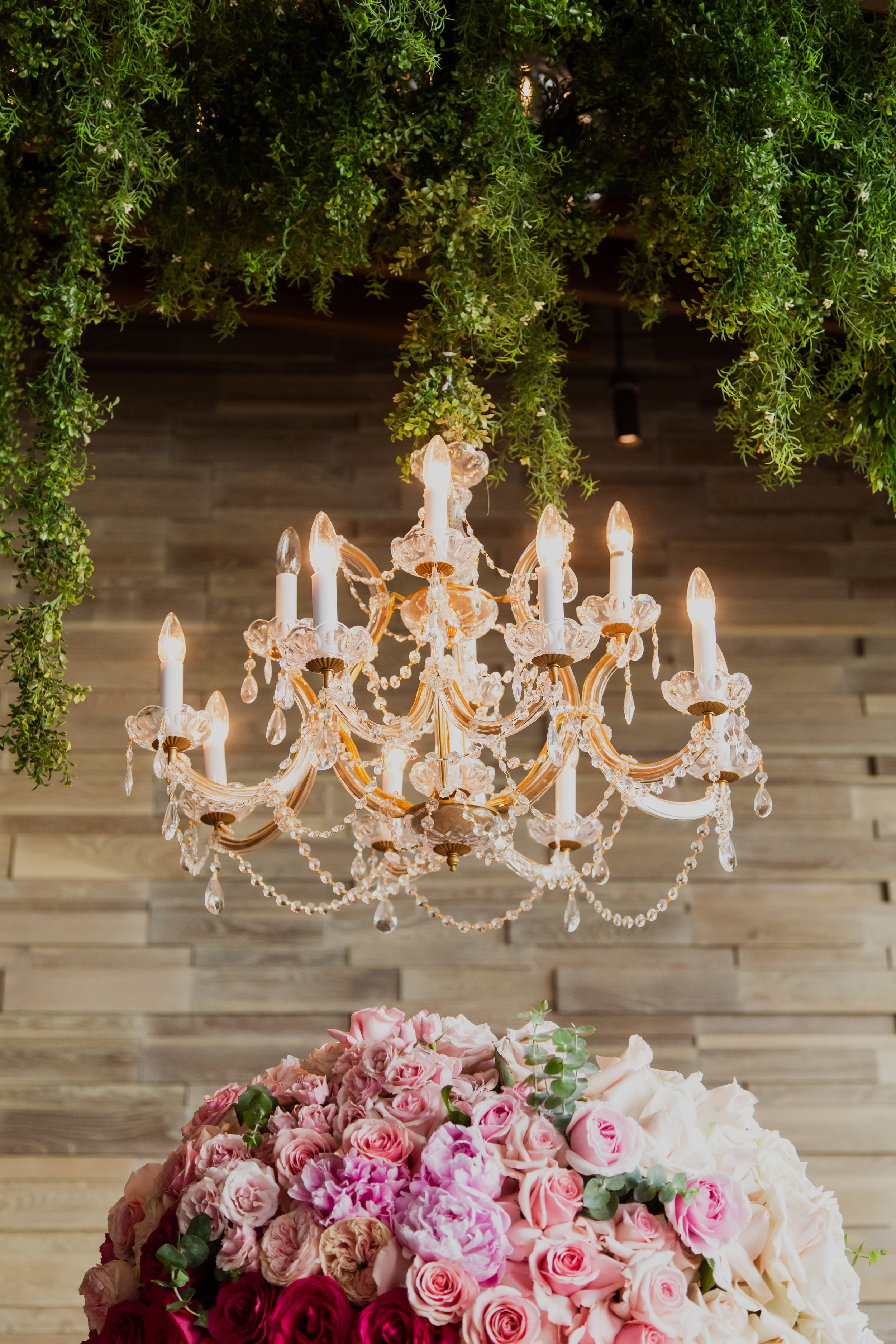 Large gold chandelier over ombre centerpiece. Las Vegas Wedding Planner & Event Designer  Andrea Eppolito Events  · Photography by  Adam Frazier Photo  · Video by  M Place Productions  · Floral & Decor by  DBD Las Vegas  · Venue  ARIA Primrose Ballroom  · Cigar Band by  Royal Cigar Company  and  Jason of Beverly Hills  · Beauty by  Glammed Up Las Vegas  · Dress by  Vera Wang  · Salon  Couture Bride Las Vegas  · Shoes  Bella Belle Shoes  · Bride  Katrina May Armenta  · Groom  Lucas Cuevas