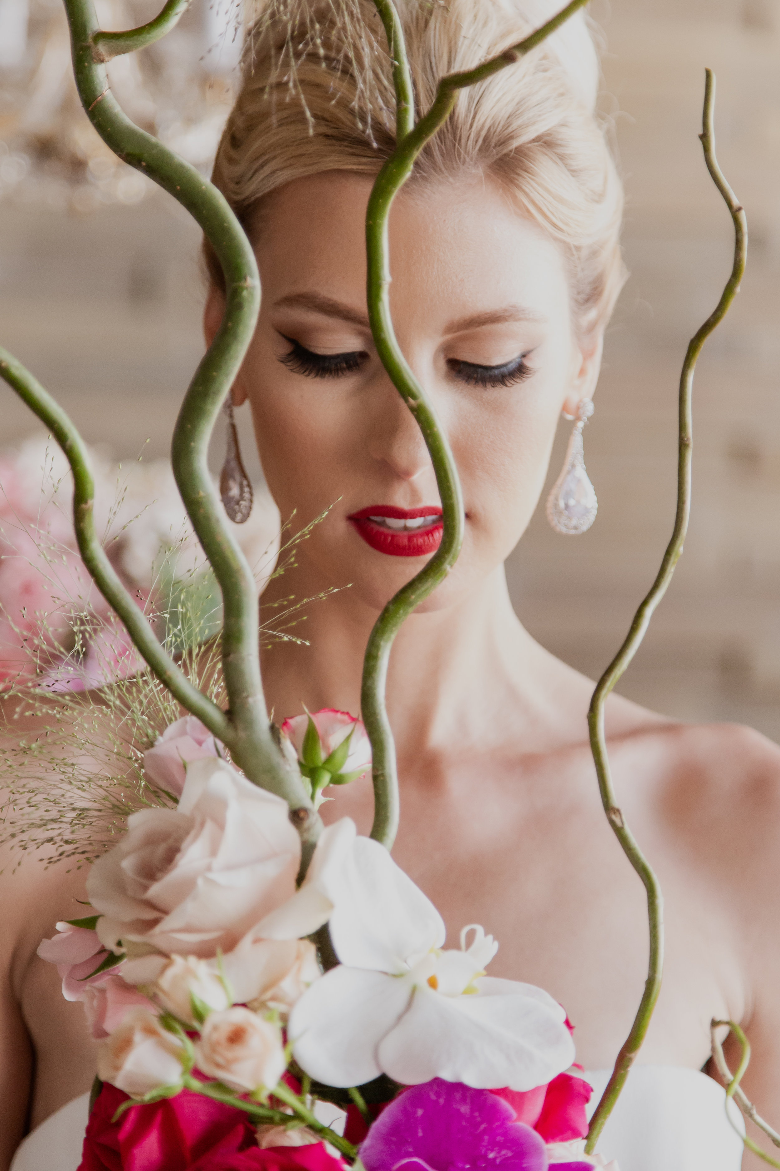 Bridal portrait through staff vines. Las Vegas Wedding Planner & Event Designer  Andrea Eppolito Events  · Photography by  Adam Frazier Photo  · Video by  M Place Productions  · Floral & Decor by  DBD Las Vegas  · Venue  ARIA Primrose Ballroom  · Cigar Band by  Royal Cigar Company  and  Jason of Beverly Hills  · Beauty by  Glammed Up Las Vegas  · Dress by  Vera Wang  · Salon  Couture Bride Las Vegas  · Shoes  Bella Belle Shoes  · Bride  Katrina May Armenta  · Groom  Lucas Cuevas