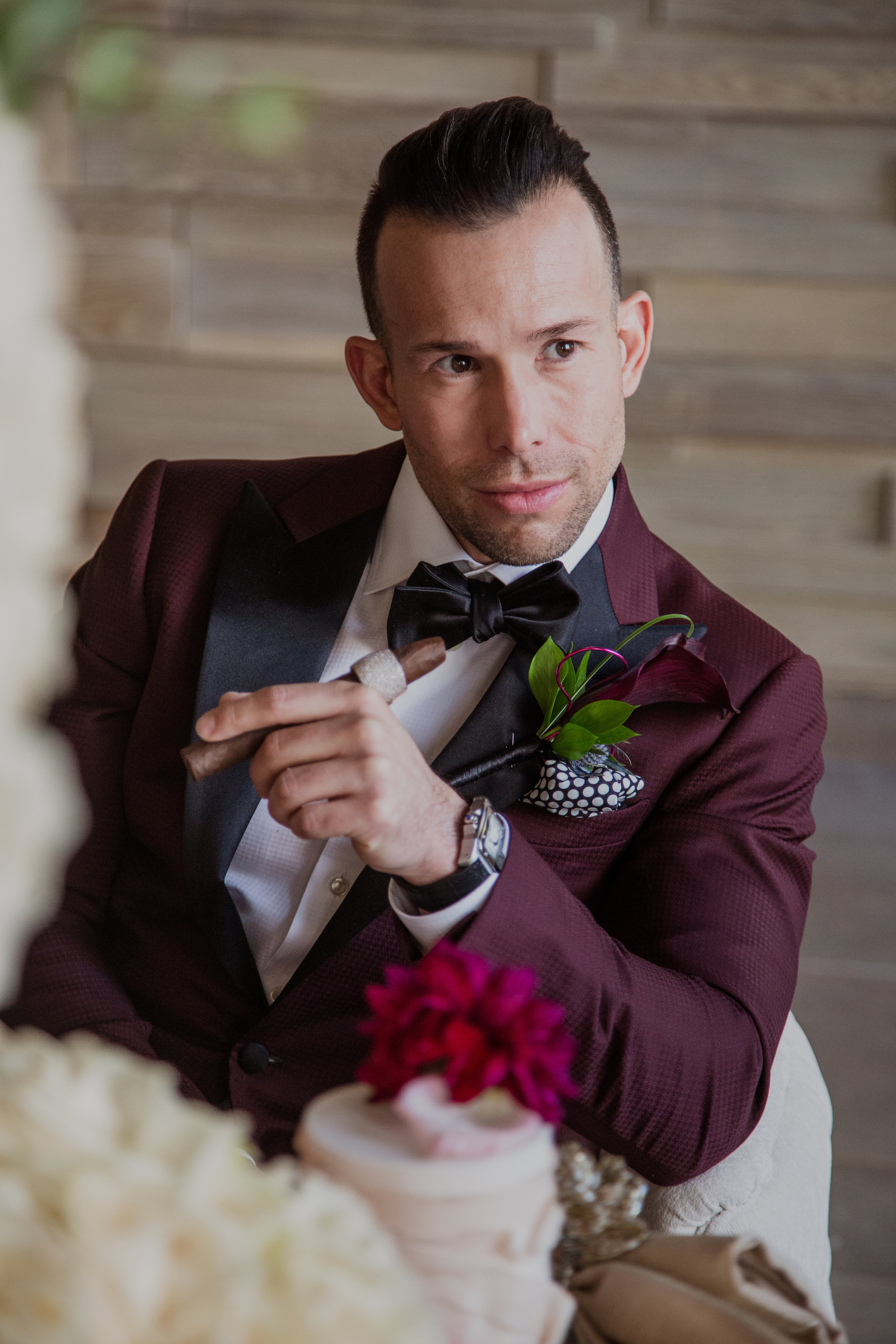 Groom with diamond cigar band at wedding. Las Vegas Wedding Planner & Event Designer  Andrea Eppolito Events  · Photography by  Adam Frazier Photo  · Video by  M Place Productions  · Floral & Decor by  DBD Las Vegas  · Venue  ARIA Primrose Ballroom  · Cigar Band by  Royal Cigar Company  and  Jason of Beverly Hills  · Beauty by  Glammed Up Las Vegas  · Dress by  Vera Wang  · Salon  Couture Bride Las Vegas  · Shoes  Bella Belle Shoes  · Bride  Katrina May Armenta  · Groom  Lucas Cuevas