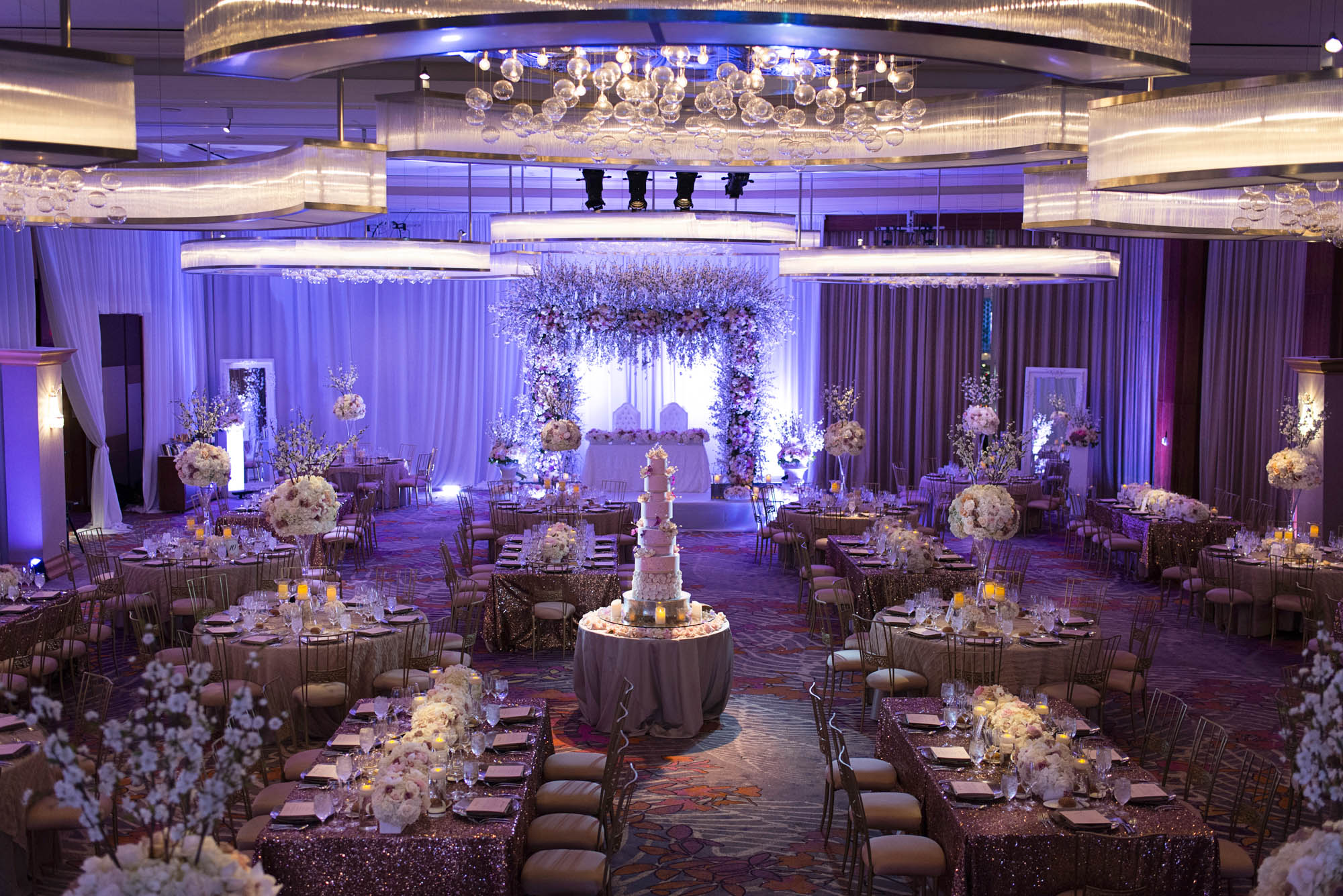 9 tiered wedding cake in the middle of a wedding reception at Mandarin Oriental. Las Vegas Wedding Planner Andrea Eppolito. Photo by AltF.