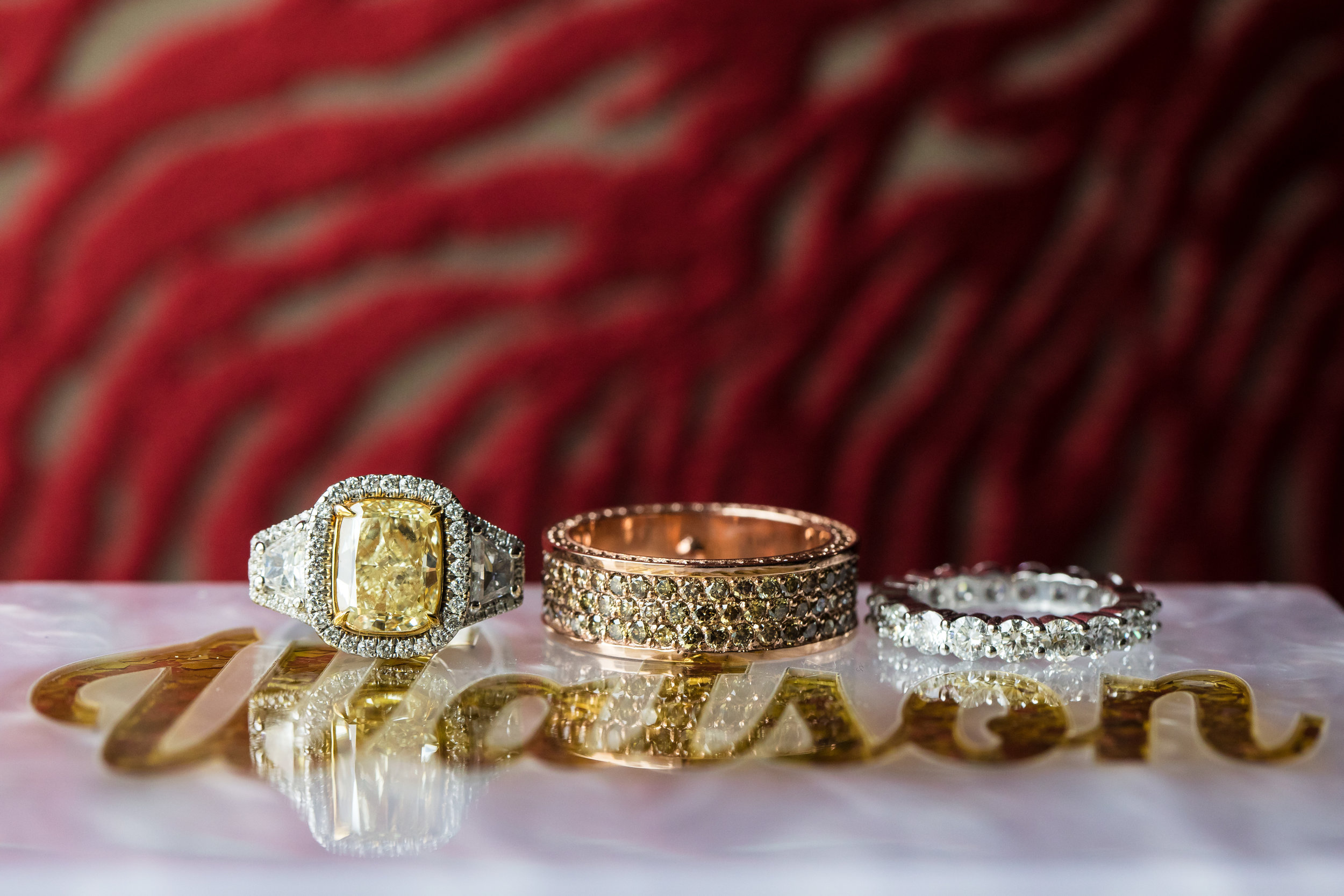 Big diamond engagement ring by Jacob of Beverly Hills. Cognac diamonds for the groom, and a yellow diamond for the bride.  Designed and Produced by Las Vegas Wedding Planner Andrea Eppolito. Images by Brian Leahy.