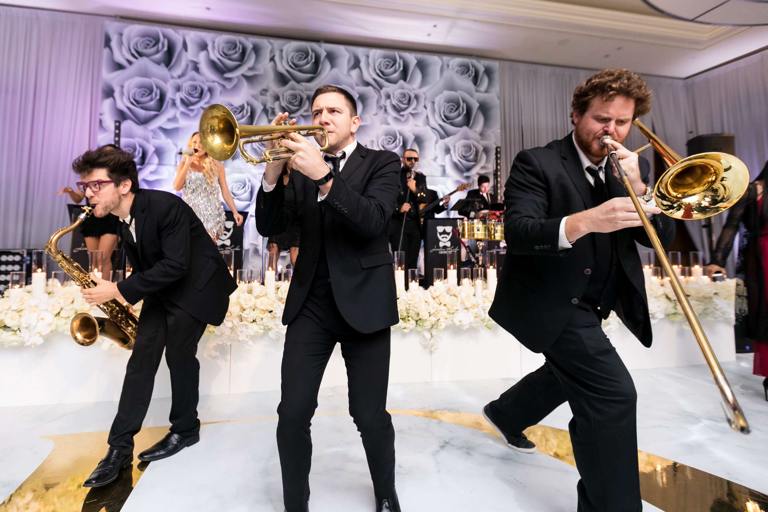 Jordan Kahn Orchestra playing in the middle of the dance floor.  Designed and Produced by Las Vegas Wedding Planner Andrea Eppolito. Images by Brian Leahy.