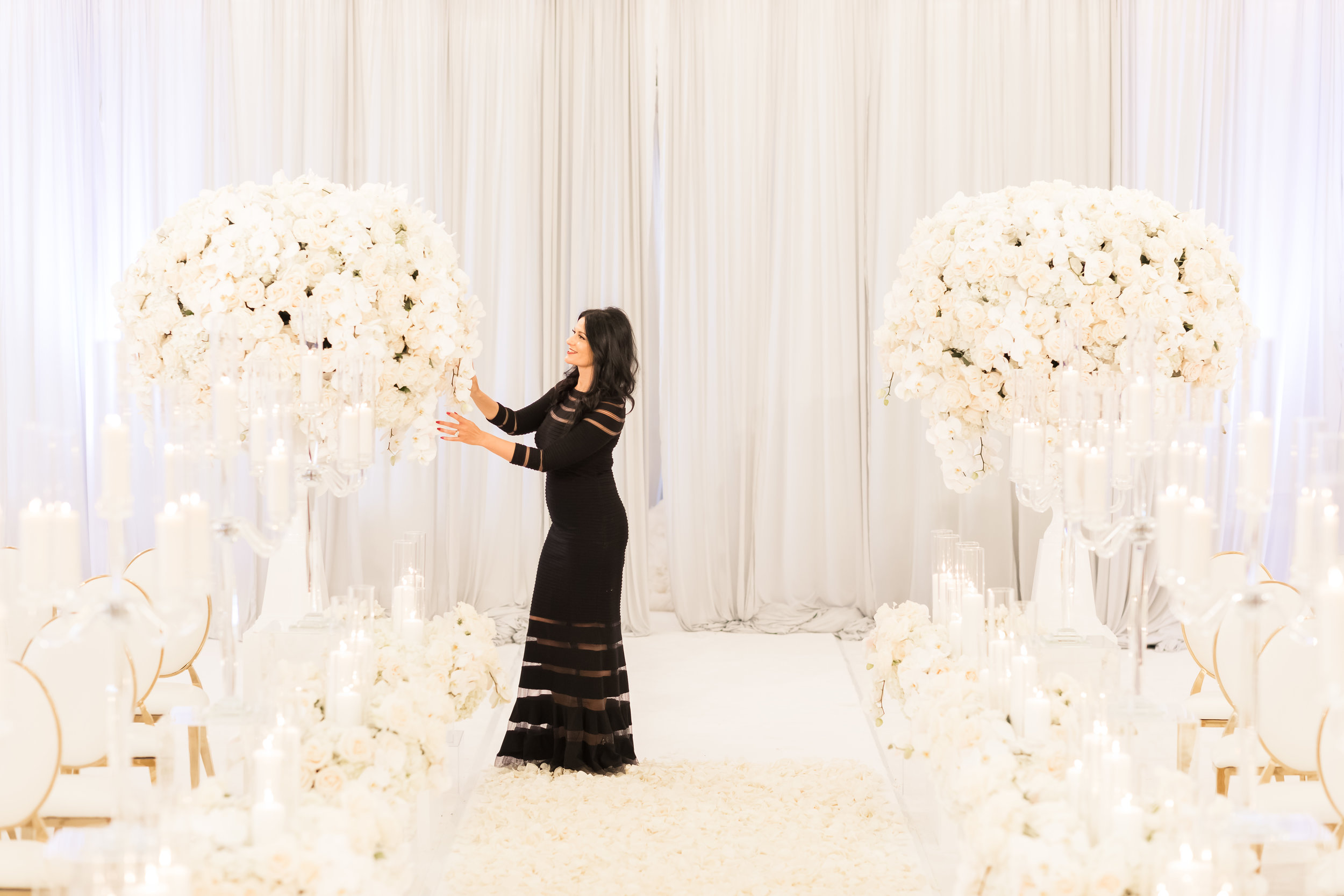 Las Vegas Wedding Planner Andrea Eppolito putting the finishing touches on a wedding ceremony. Photo by Brian Leahy.