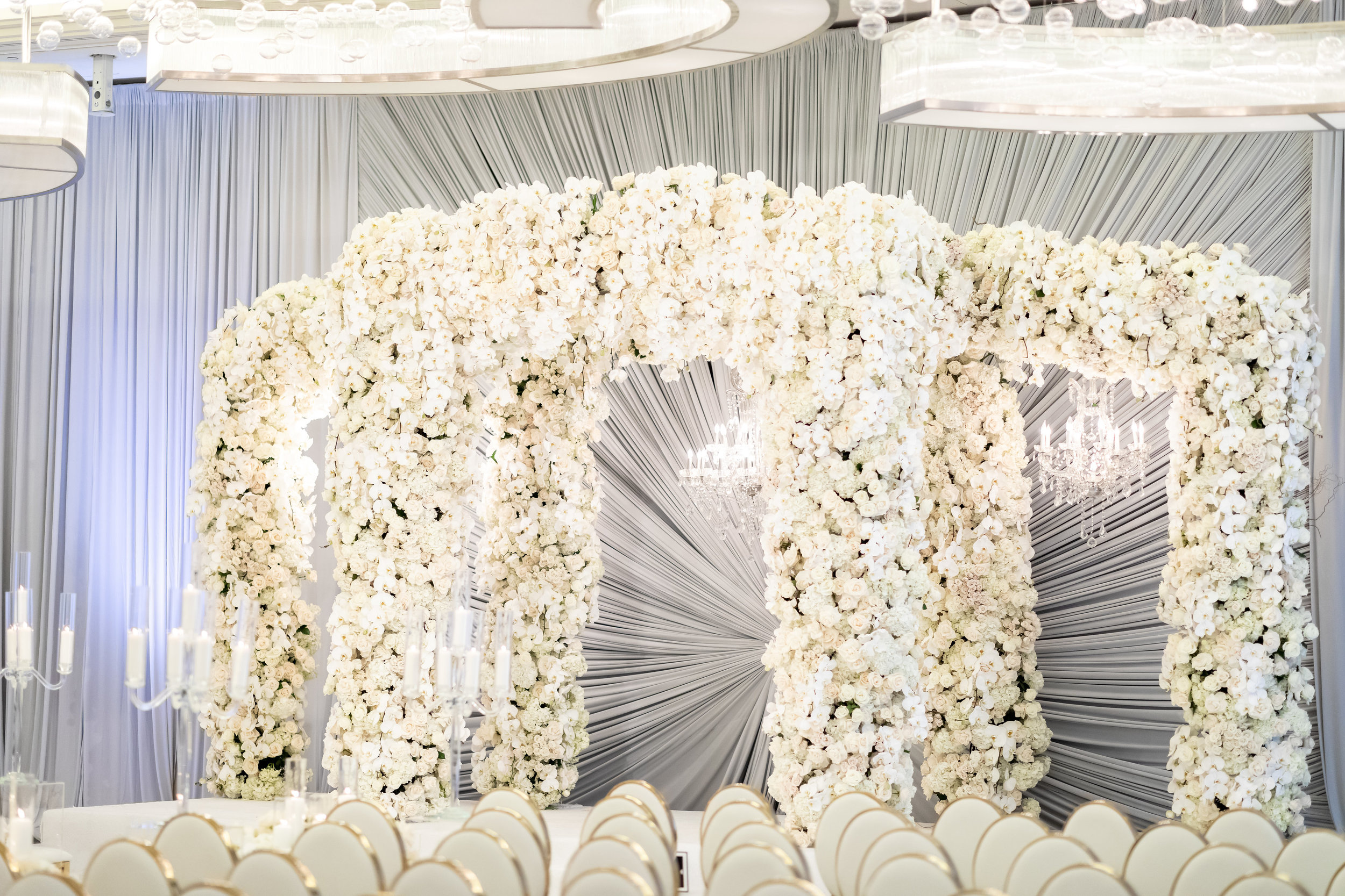 Luxury wedding ceremony in Las Vegas. White, grey, and gold celebrity wedding at Waldorf Astoria.  Designed and Produced by Las Vegas Wedding Planner Andrea Eppolito. Images by Brian Leahy.