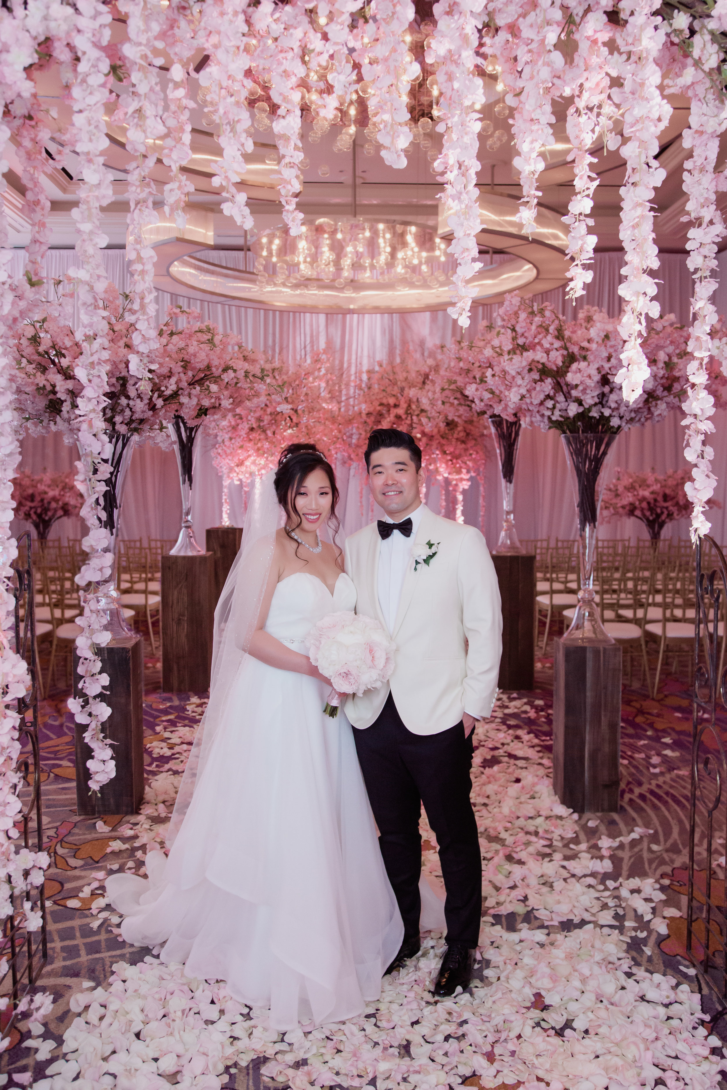 Pretty in pink cherry blossom wedding by Las Vegas Wedding Planner Andrea Eppolito at the Waldorf Astoria. Photo by Adam Frazier.