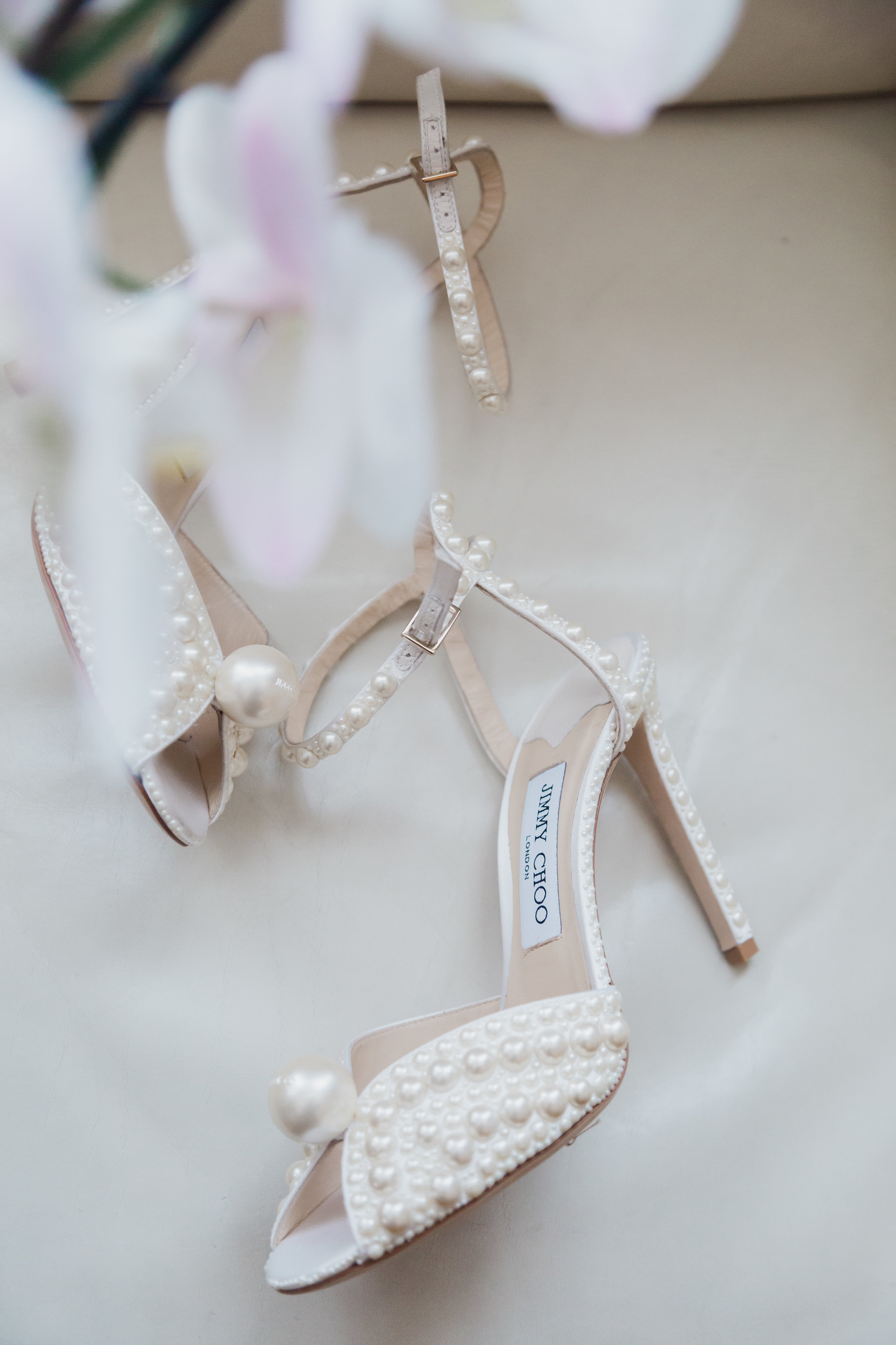 Pearl and White Jimmy Choo Bridal Shoes. Wedding Planning and Event Design by Andrea Eppolito www.andreaeppolitoevents.com. Photos by Adam Frazier.