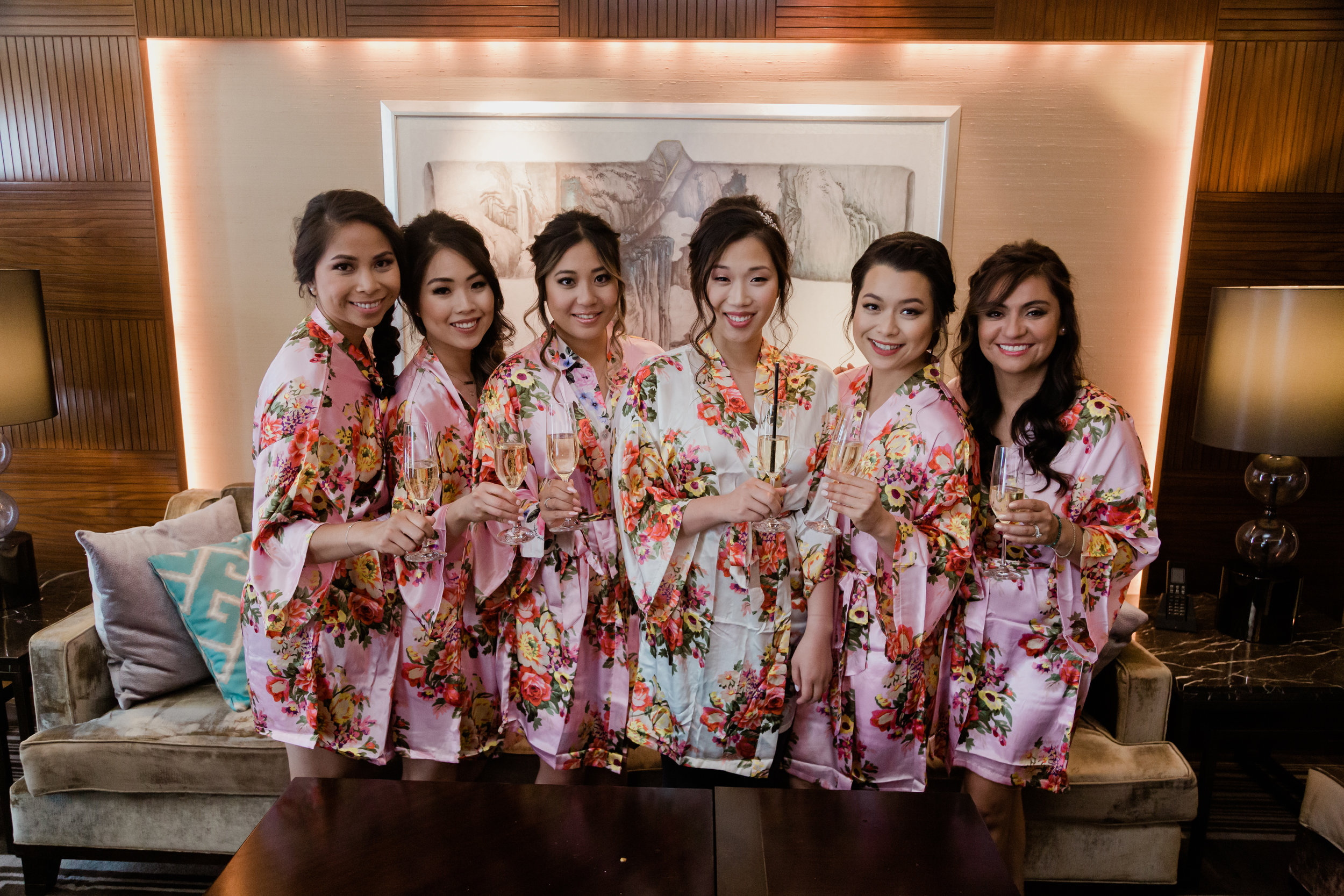 Beautiful bridesmaids in floral robes. Wedding Planning and Event Design by Andrea Eppolito www.andreaeppolitoevents.com. Photos by Adam Frazier.