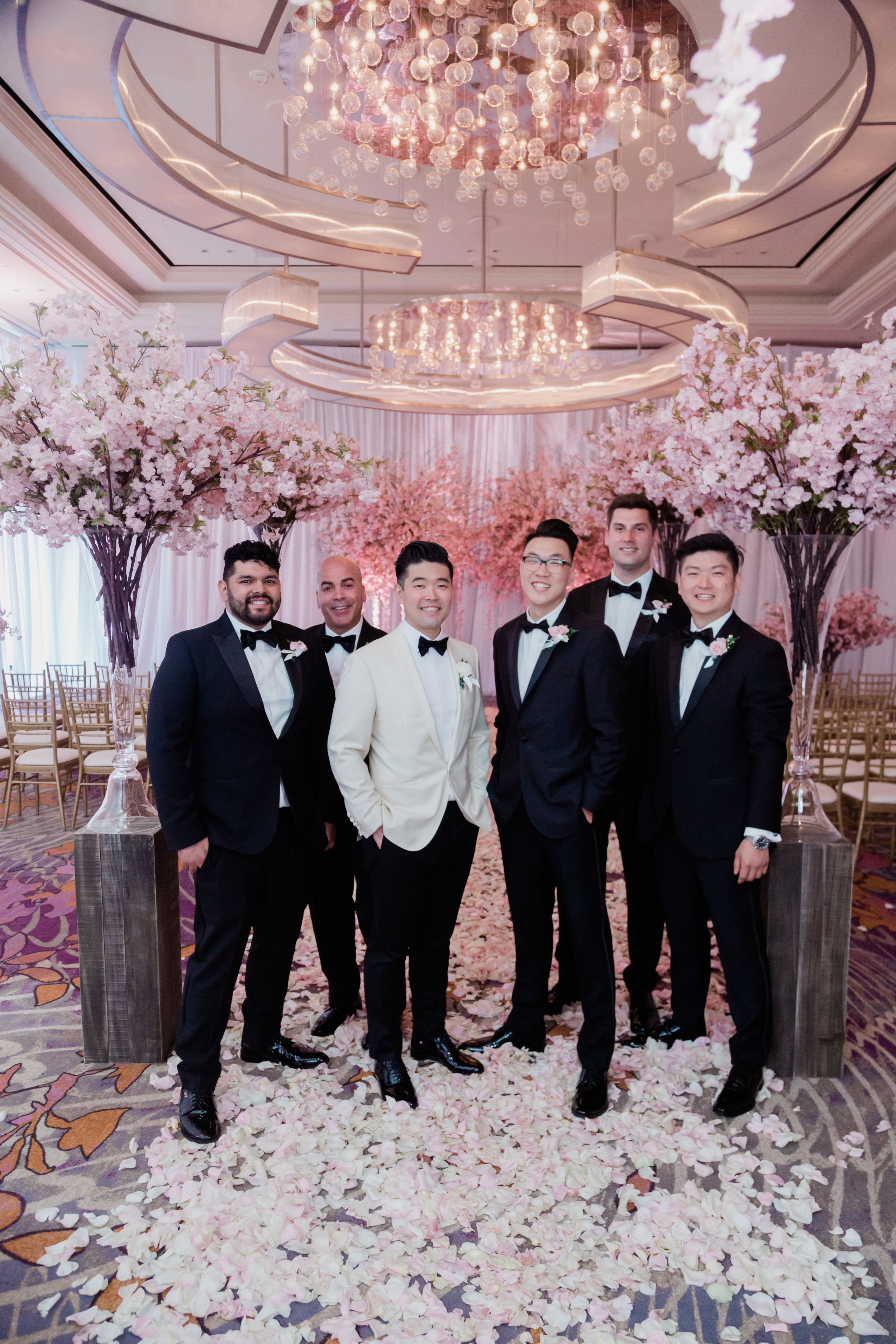 Groomsmen at a pretty in pink cherry blossom wedding. Las Vegas Wedding Planner Andrea Eppolito. Photo by Adam Frazier.