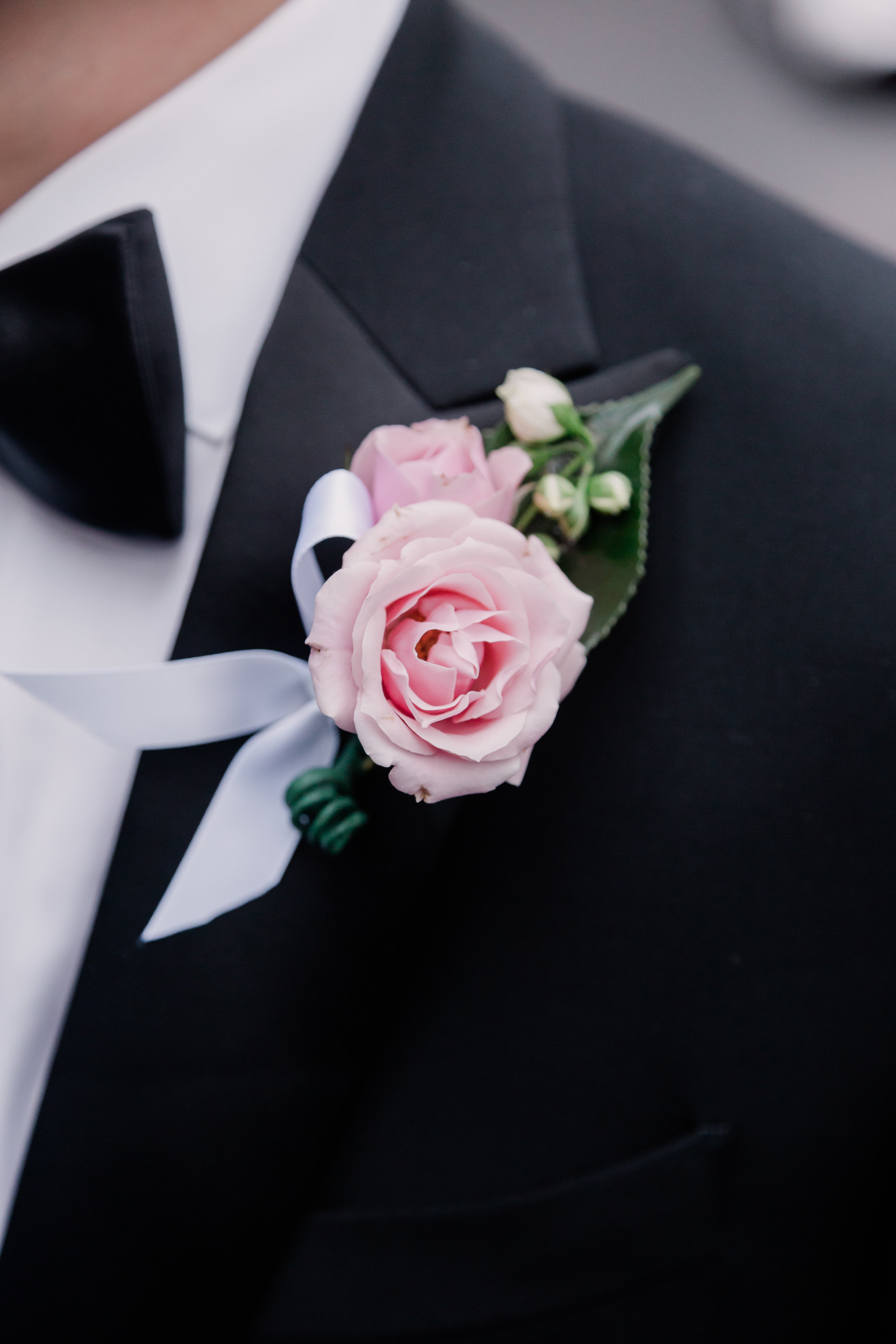 Pale pink rose boutonniere. Las Vegas Wedding Planner Andrea Eppolito. Photo by Adam Frazier.
