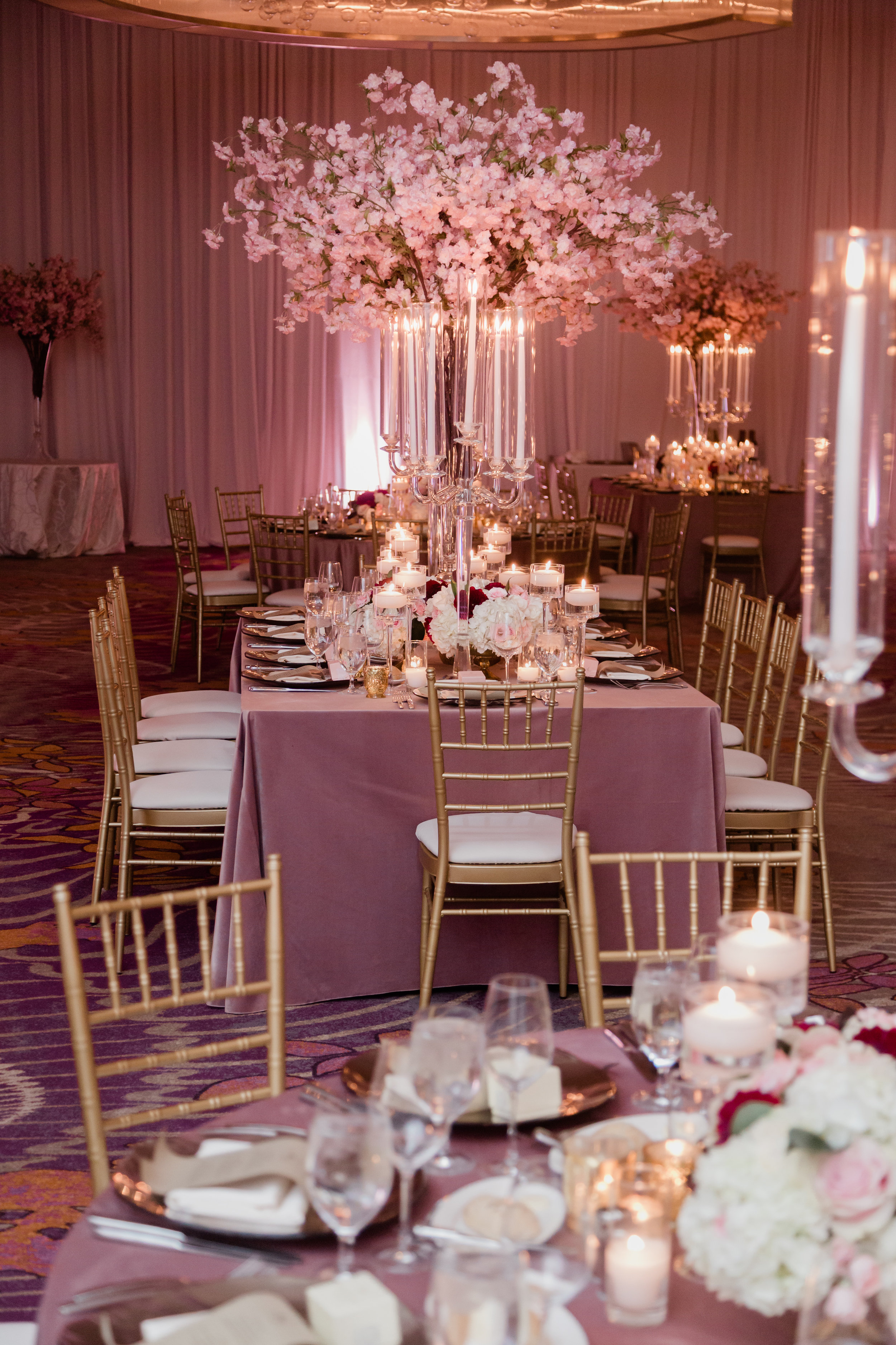 Luxury cherry blossom centerpieces at the Waldorf Astoria Las Vegas. Las Vegas Wedding Planner Andrea Eppolito. Photo by Adam Frazier.