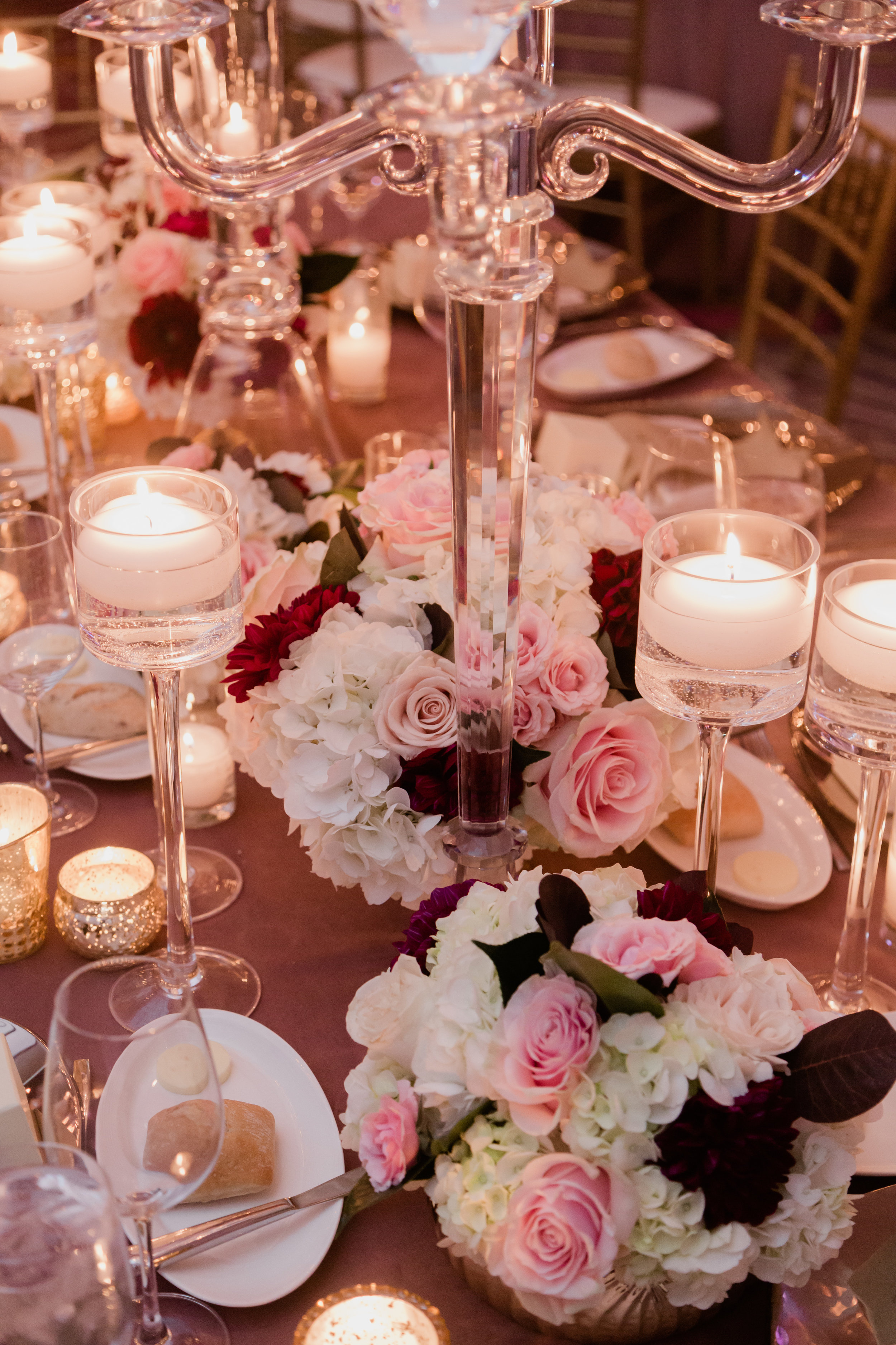 Pink and burgundy wedding centerpiece in Las Vegas. Las Vegas Wedding Planner Andrea Eppolito. Photo by Adam Frazier.
