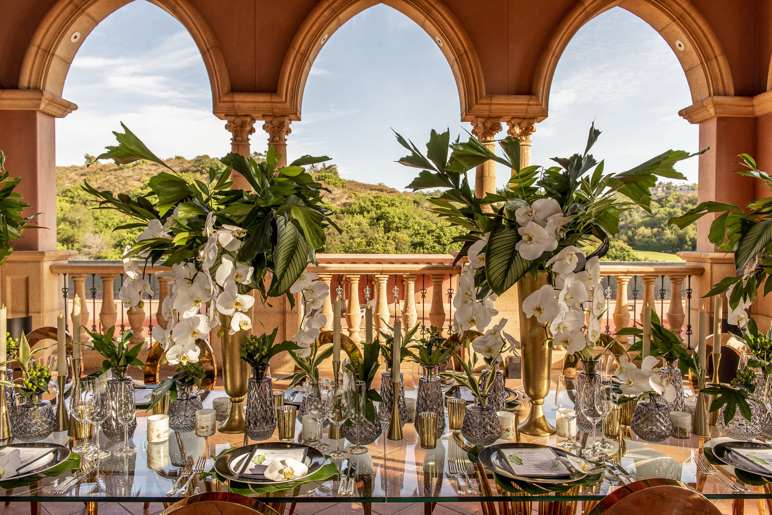 Tropical wedding centerpiece at the Fairmont Grand Del Mar. Wedding Planner www.andreaeppolitoevents.com. Photo by Boyd Harris.