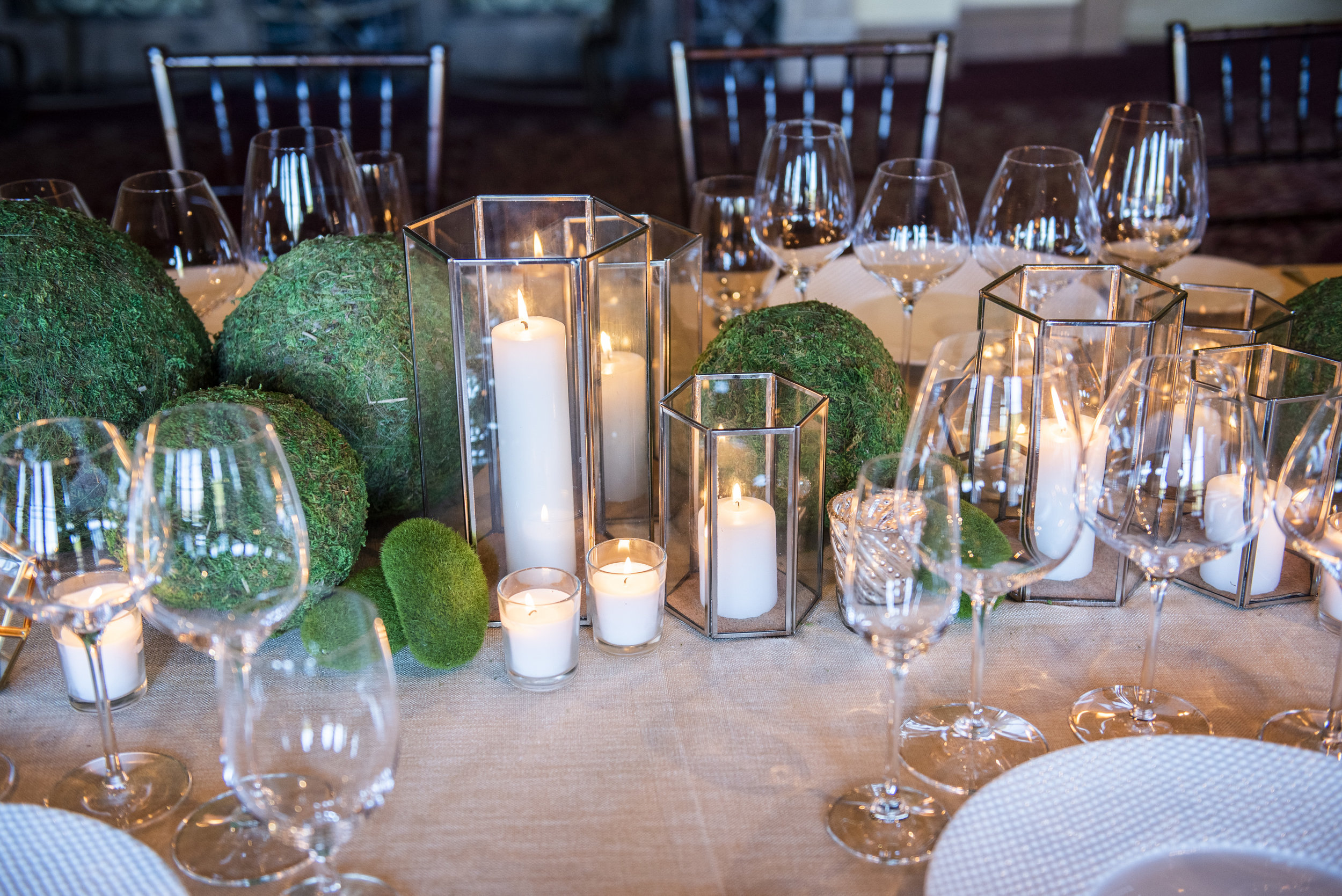 Candles and greenery.  The Addison at The Fairmont Grand Del Mar. Photo by Boyd Harris.