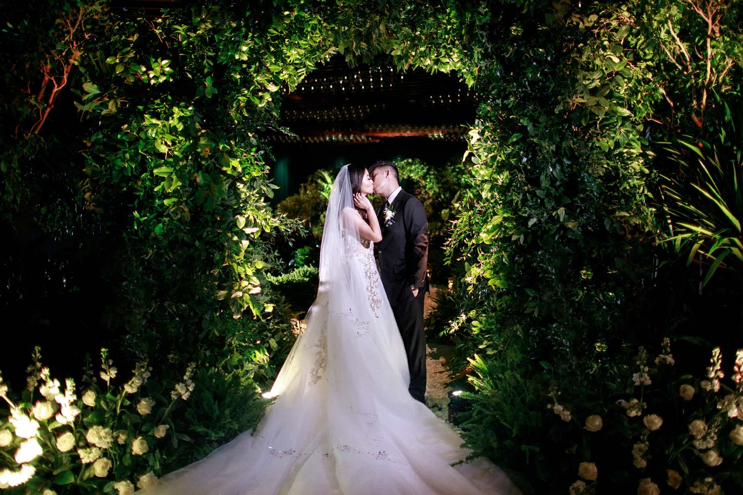 Bride and groom kissing in their ceremony space. Luxury Las Vegas Wedding Planner Andrea Eppolito. www.andreaeppolitoevents.com. Photo by Rene Zadori.