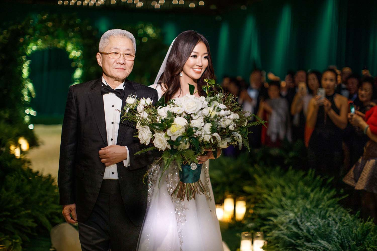 Bride walking down the aisle with her father. Luxury Las Vegas Wedding Planner Andrea Eppolito. www.andreaeppolitoevents.com. Photo by Rene Zadori.