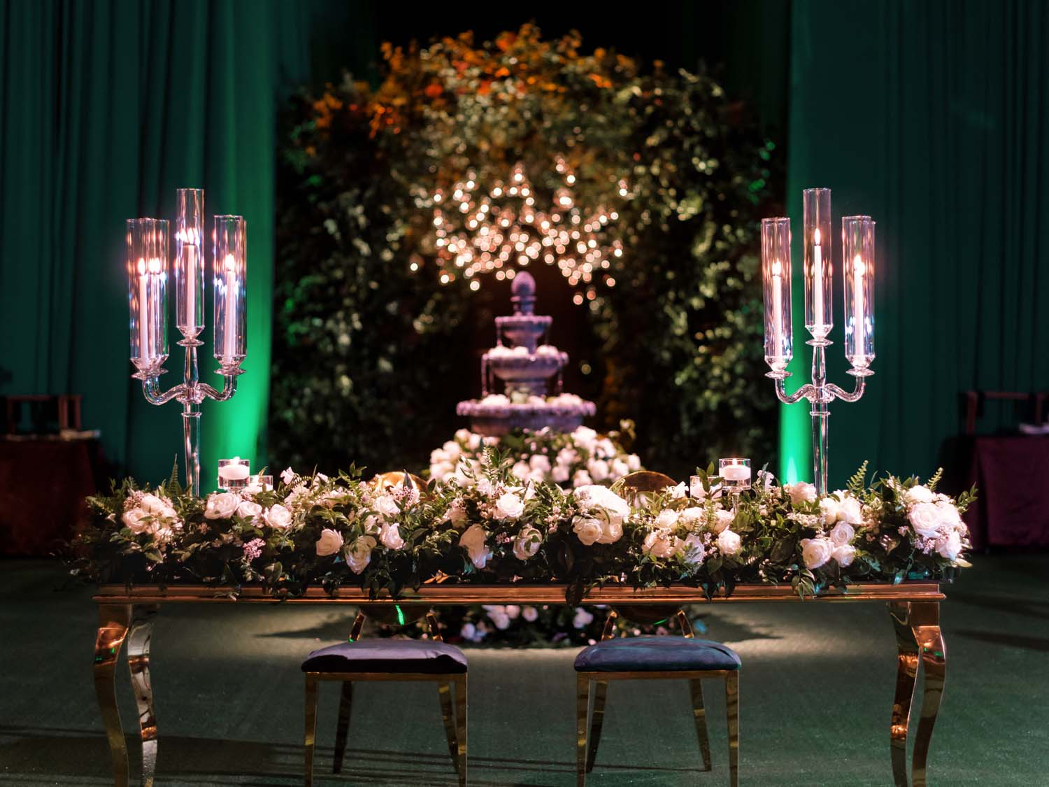 Gold and mirrored sweetheart tables with candles and a fountain. Luxury Las Vegas Wedding Planner Andrea Eppolito. www.andreaeppolitoevents.com. Photo by Rene Zadori.