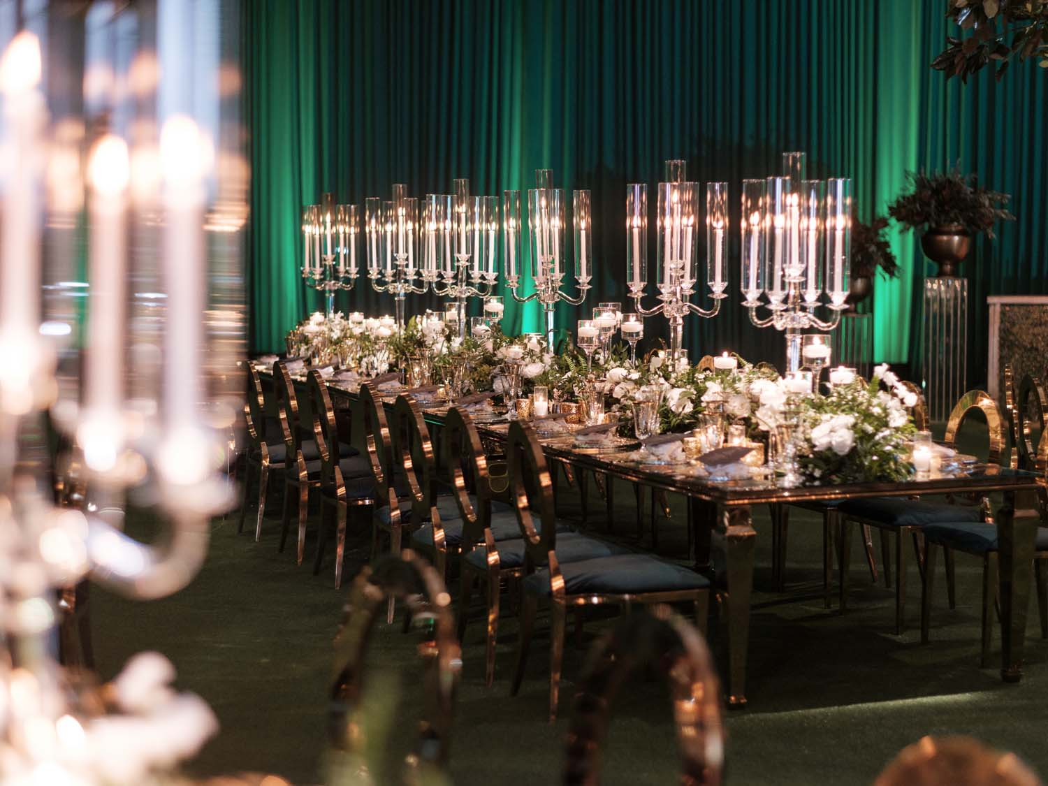Long mirrored tables with candelabras in Green Wedding. Luxury Las Vegas Wedding Planner Andrea Eppolito. www.andreaeppolitoevents.com. Photo by Rene Zadori.