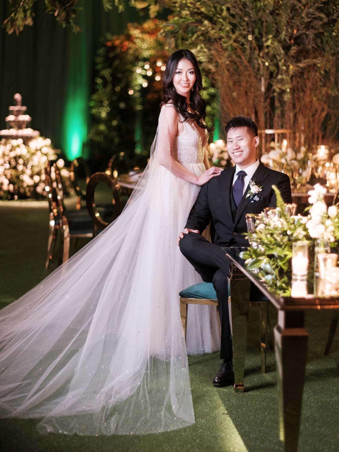 Bride n Erin Cole and Groom in tuxedo in all green city of oz wedding at ARIA Las Vegas. Luxury Las Vegas Wedding Planner Andrea Eppolito. www.andreaeppolitoevents.com. Photo by Rene Zadori.