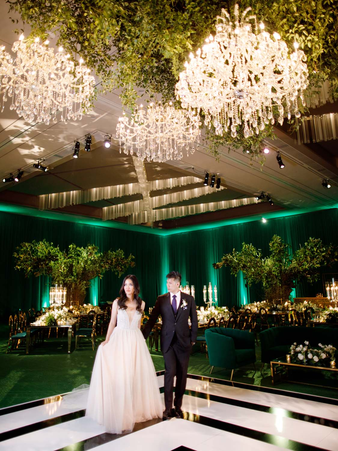 Bride and groom on black and white dance floor in all green wedding. Luxury Las Vegas Wedding Planner Andrea Eppolito. www.andreaeppolitoevents.com. Photo by Rene Zadori.
