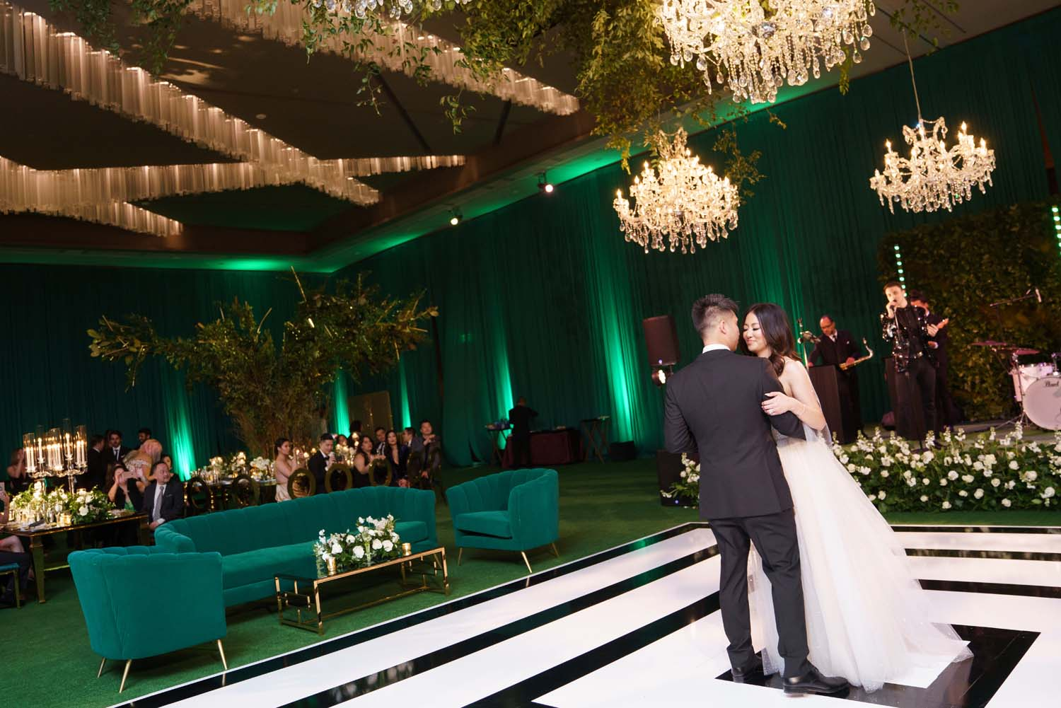 Bride and groom first dance in deep green city of oz wedding. Luxury Las Vegas Wedding Planner Andrea Eppolito. www.andreaeppolitoevents.com. Photo by Rene Zadori.
