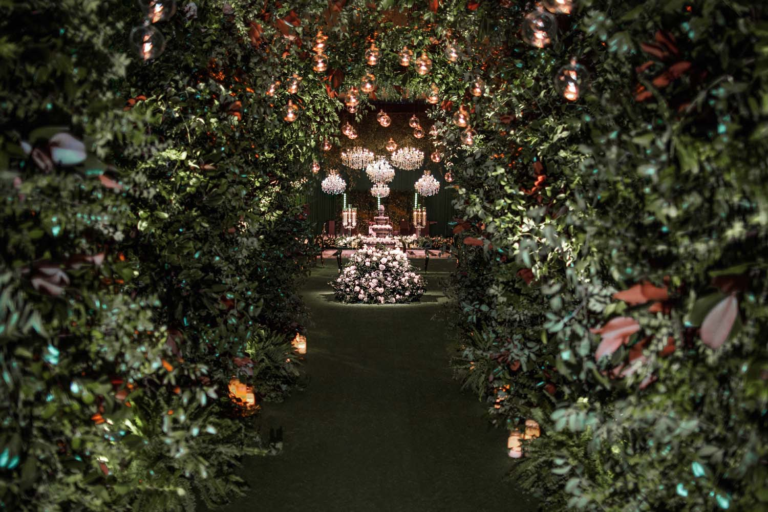 Green tunnel with fountain and chandeliers. Luxury Las Vegas Wedding Planner Andrea Eppolito. www.andreaeppolitoevents.com. Photo by Rene Zadori.