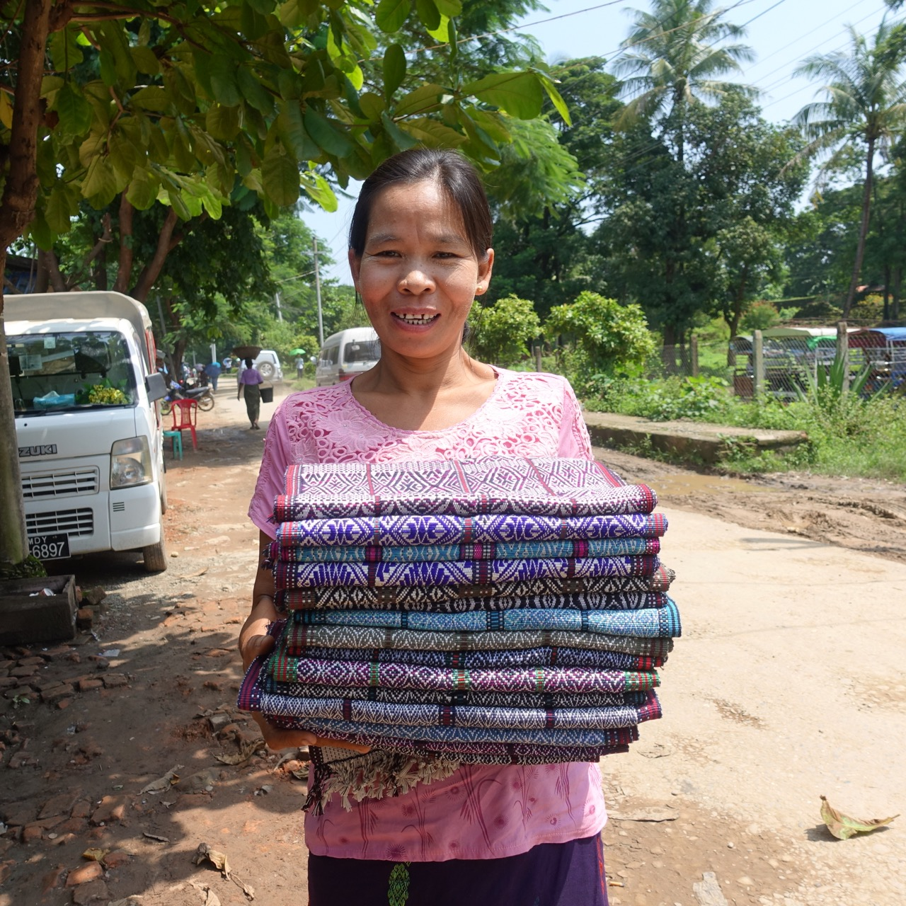 Sein Nyo Khine  was born an entrepreneur and has been working in the craft industry since she was young. She works with many weavers (often making their warps)and with jewelry makers to help them sell within the Mro community. She also collects weavings from 5 villages which she sends on to Yangon to be sold at a fair price. She lives in Kyauktaw but is originally from a small village 4 hours away in the mountains (with 2 hours of walking), she still visits there often to wildcraft materials for making natural dye!