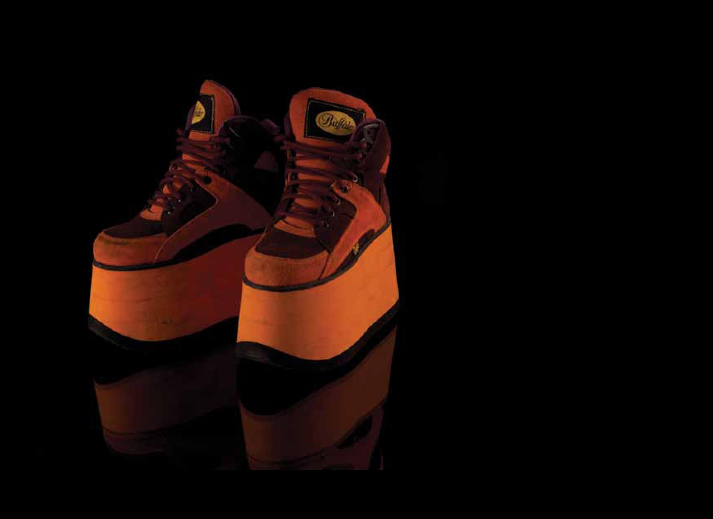 Image: Mel B, Brit Awards, 1998. Orange four-inch platform soled trainers with black tread. Designed by Buffalo