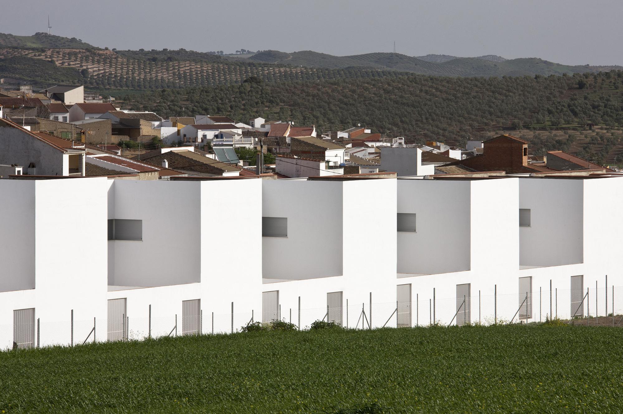 52dde1f3e8e44e9f14000077_20-social-dwellings-in-el-saucejo-su-rez-corchete_03.jpg