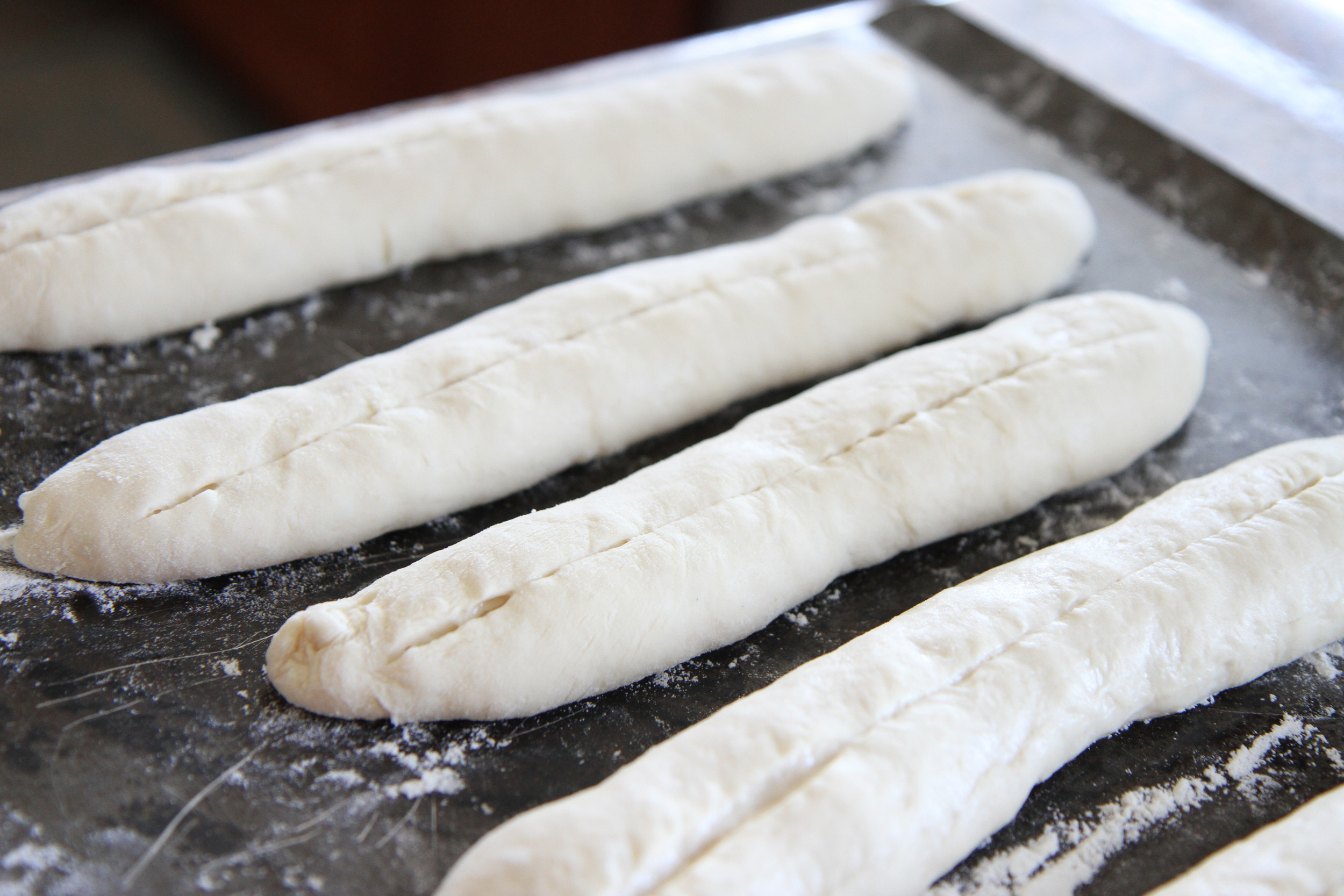 Roll out the dough into a log and make a slash down the middle