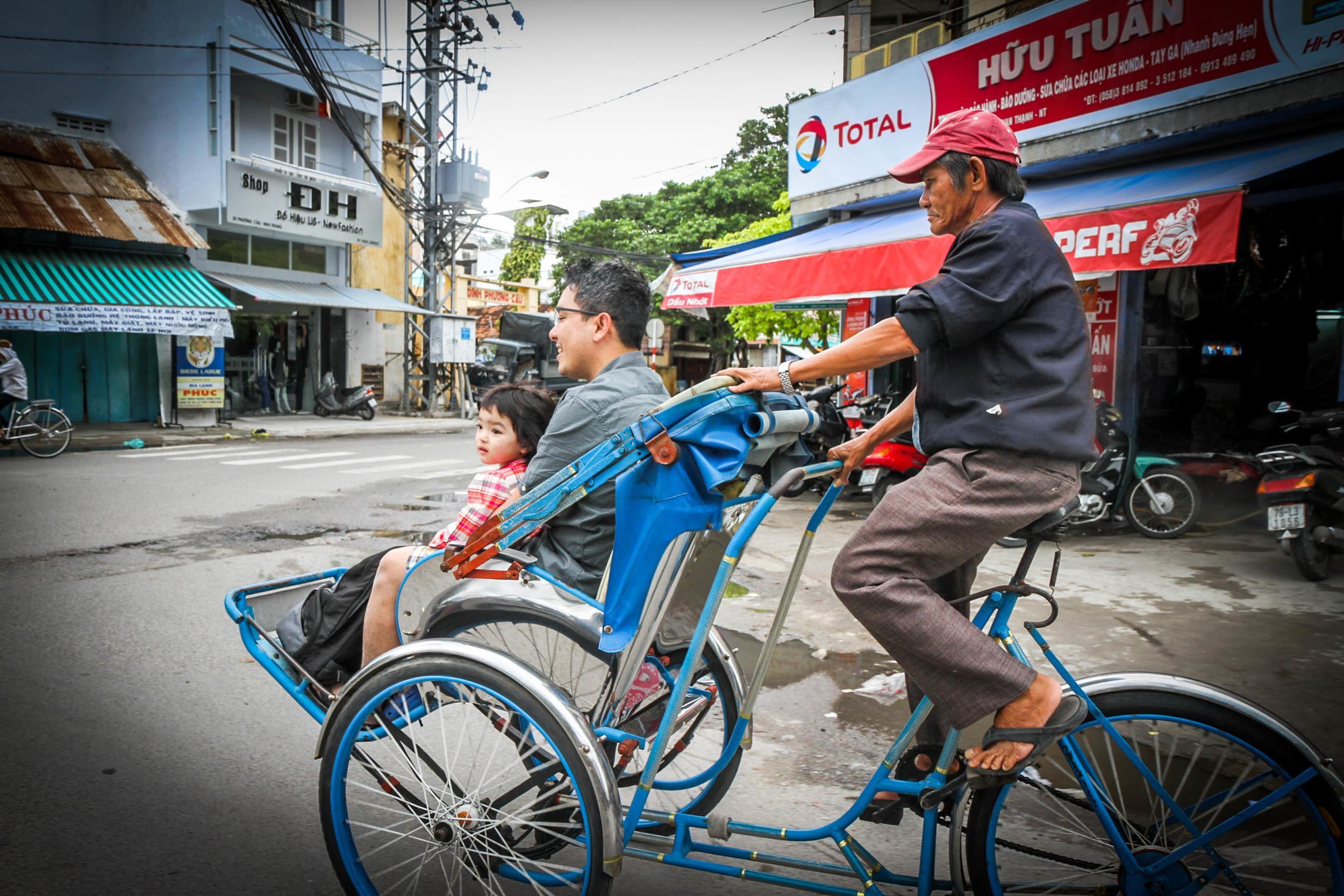 Taking tour of Nha Trang via Xich Lo, Vietnamese pedicabs.
