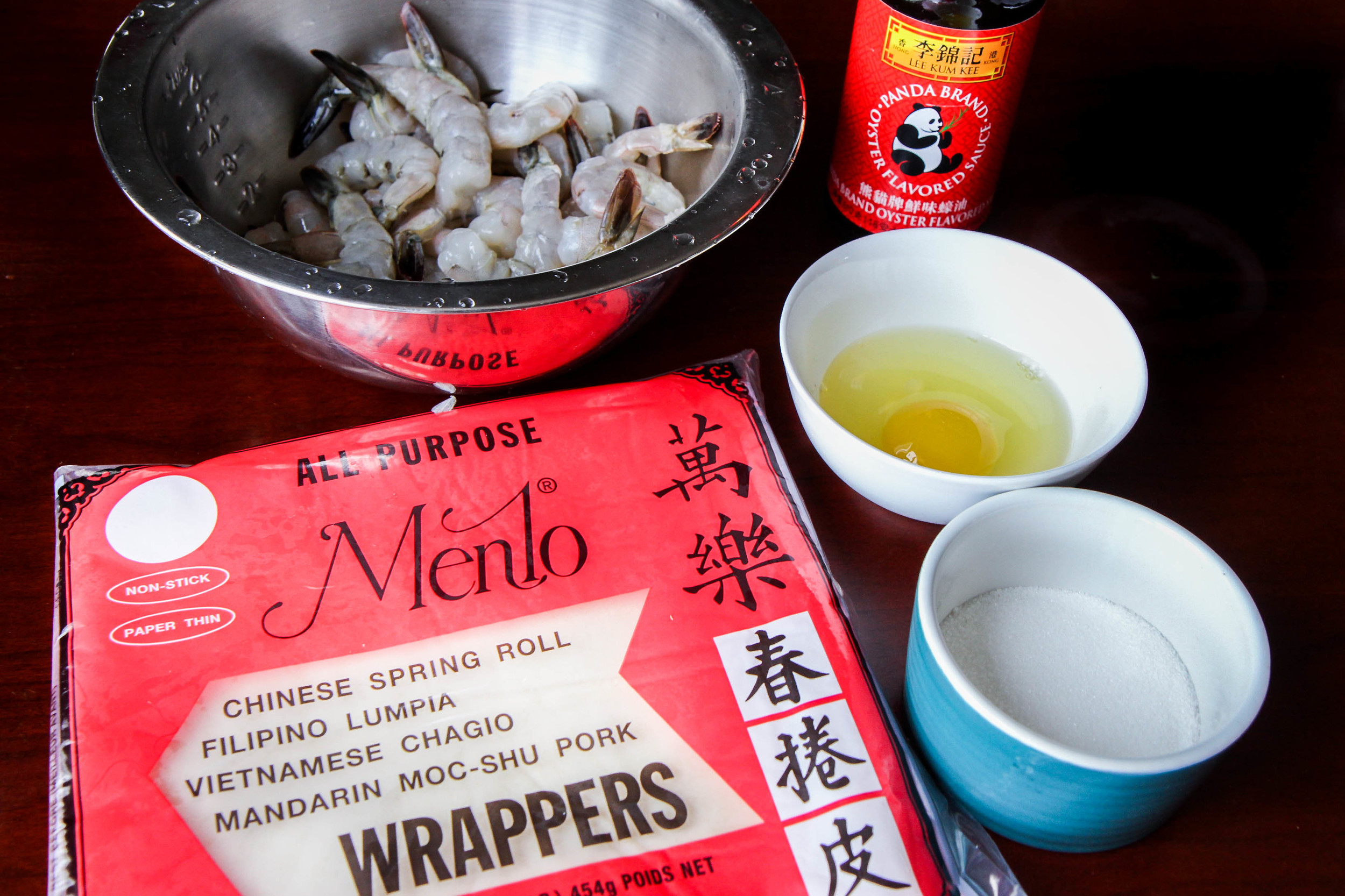 You will need: shrimp, egg roll wrapper, oyster sauce, sugar and an egg