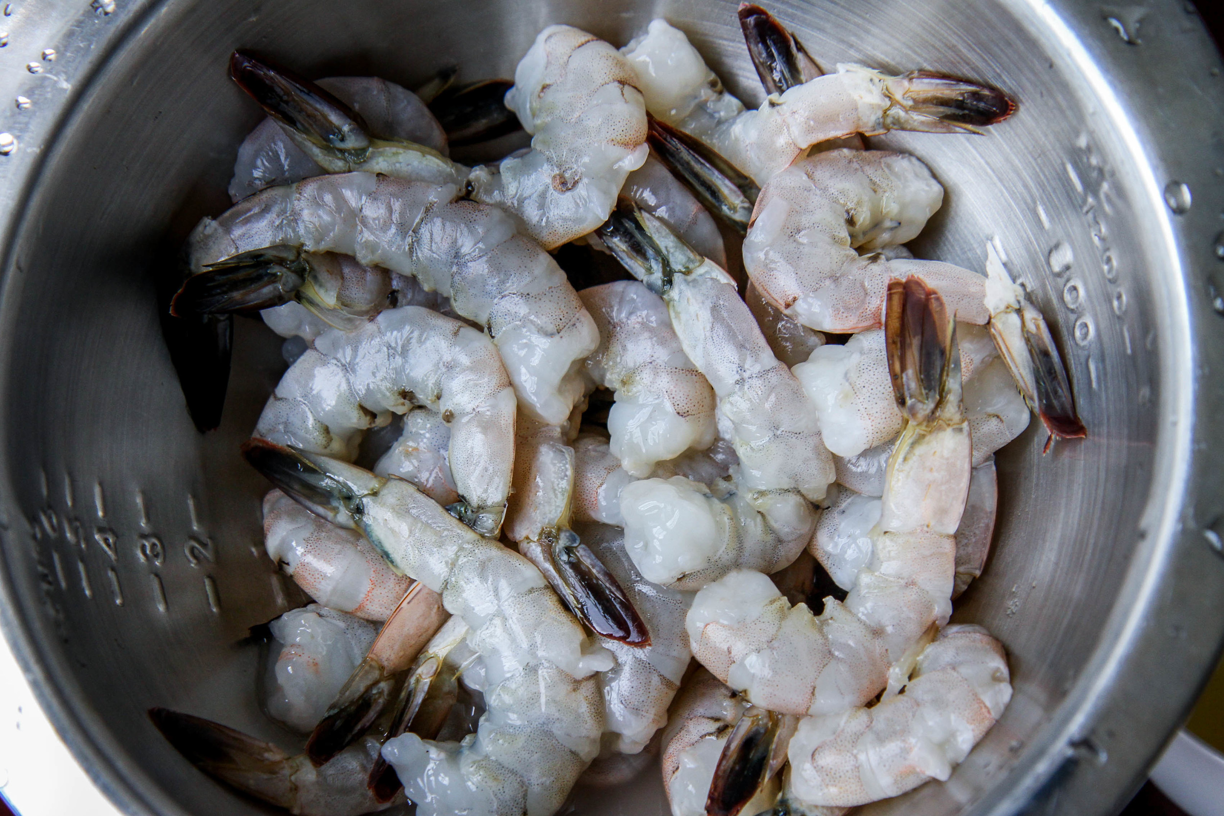 """Peel and devein the shrimp. Leave the tail on to make a """"handle""""."""