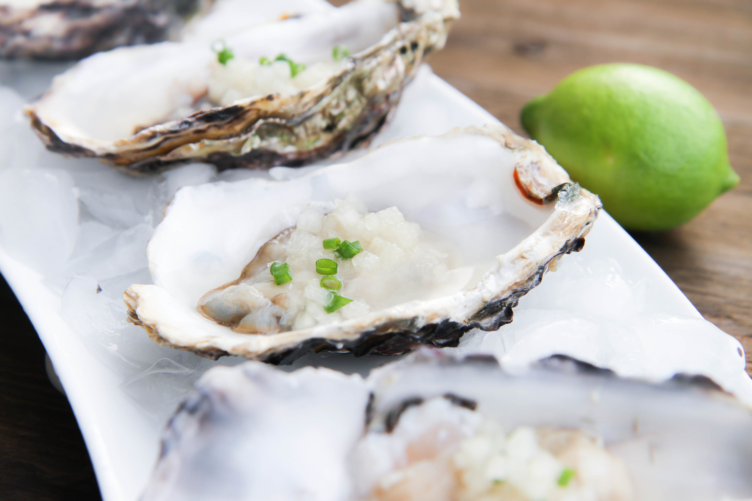 Raw oysters on the half shell with an Asian mignonette sauce