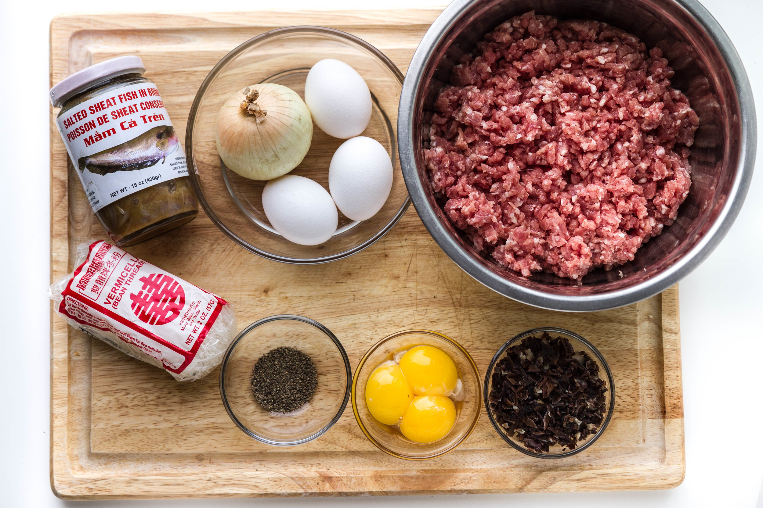 Mắm Chưng ingredients:  Mắm cá trèn, white onion, eggs, ground pork, bean thread vermicelli noodles, pepper, egg yolks and wood ear mushrooms.