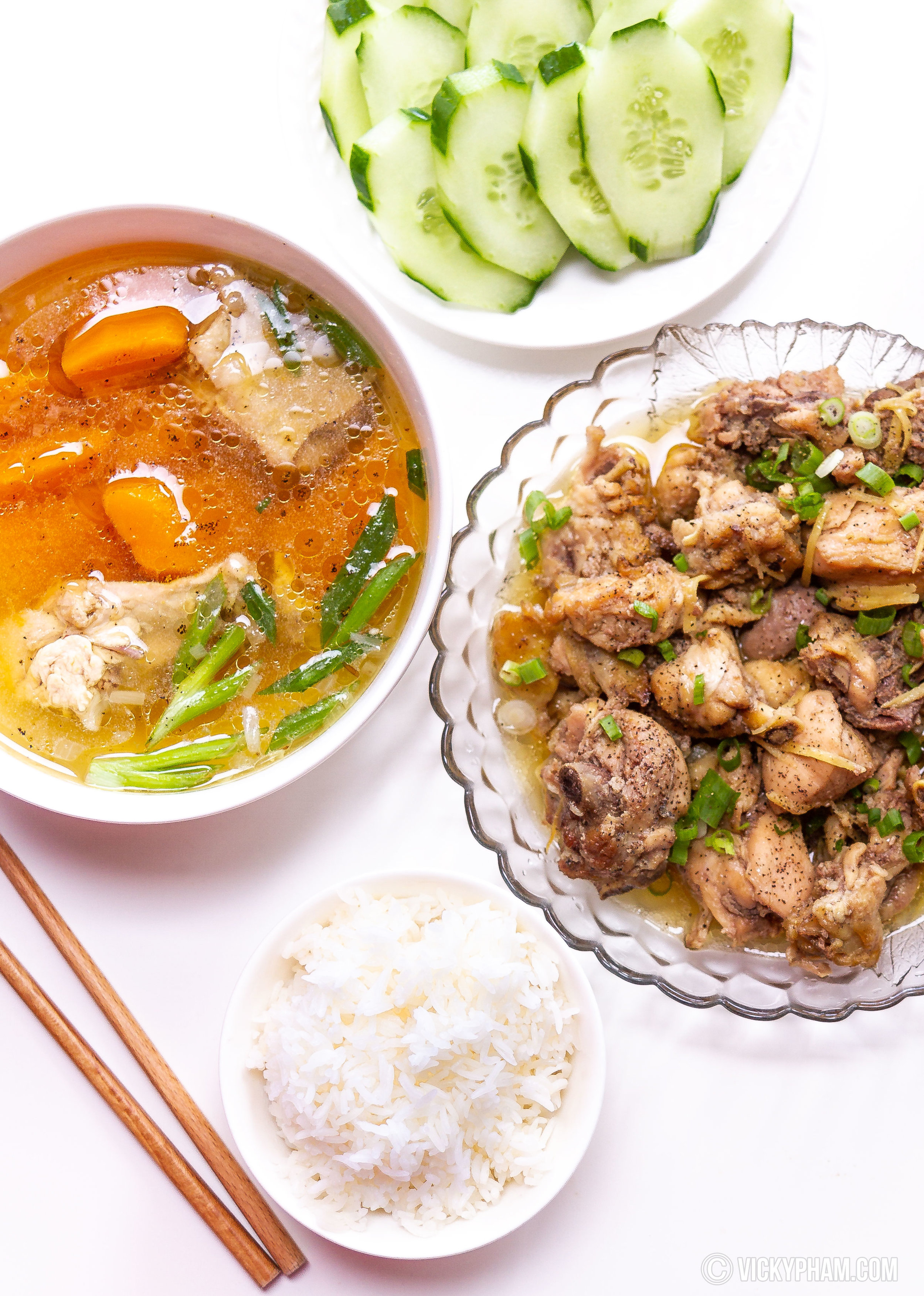 A complete Vietnamese family meal: Chicken kabocha squash soup, caramelized ginger chicken, cucumbers and steamed rice.
