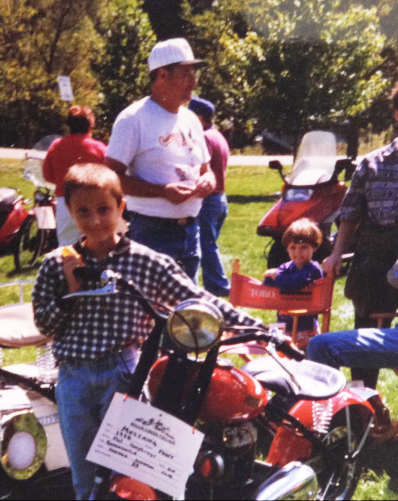 Me with my grandpa behind me at a scooter show.