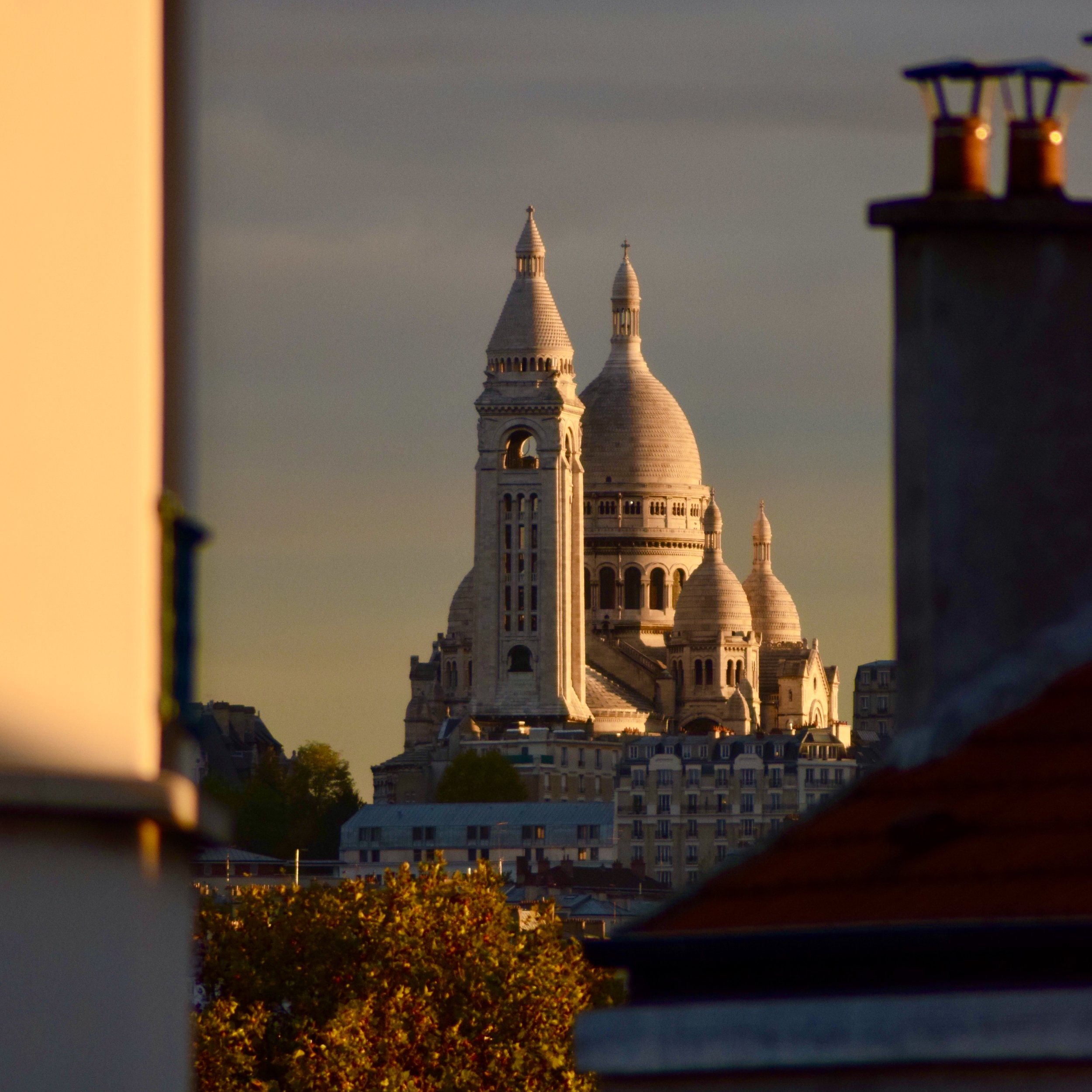 The autumn sun sets on Paris' Sacré-Cœur