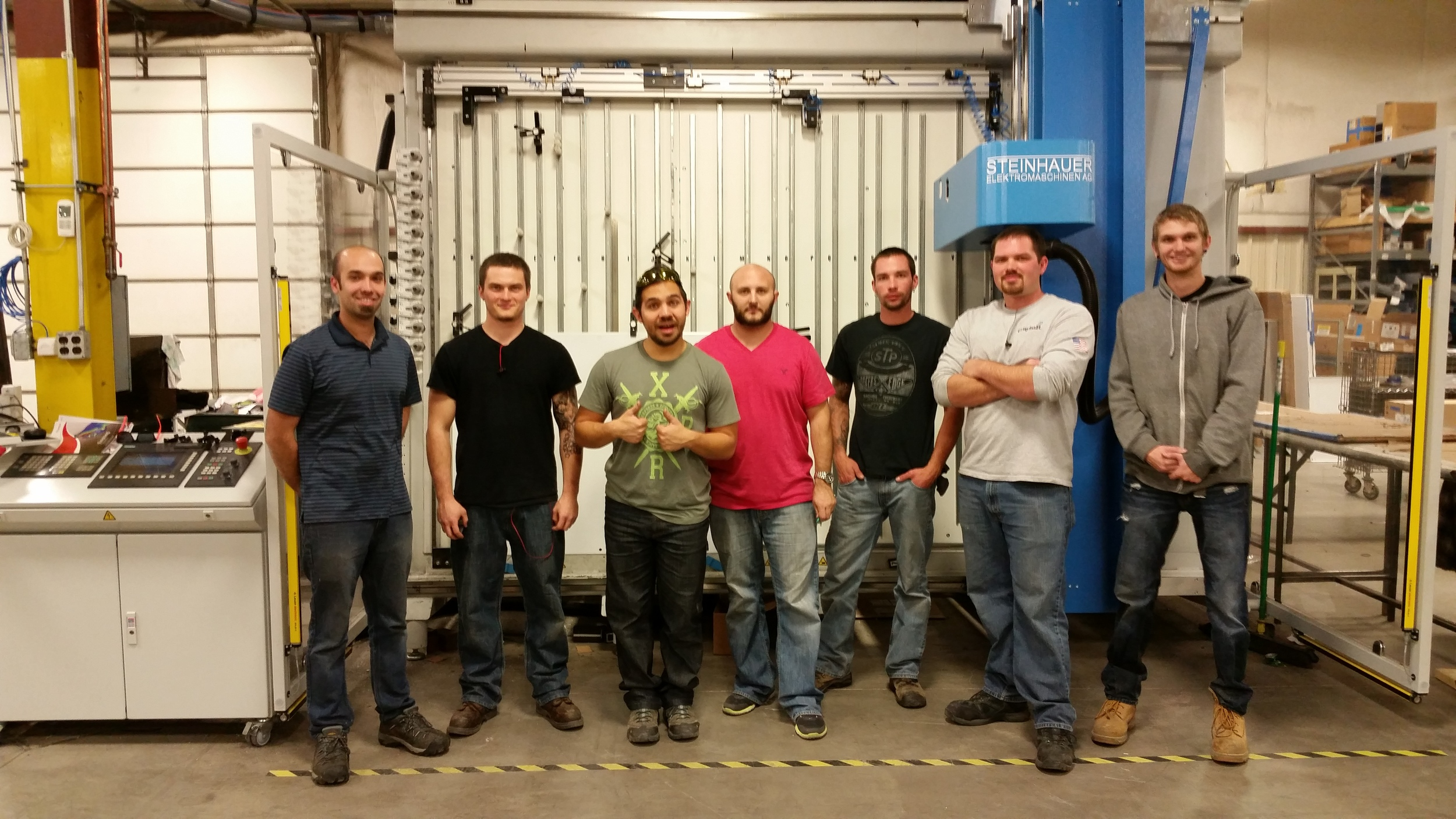 Panel Craftsmen stand in front of the MC-80. From left:Zach  Fothergill, David Ferrara, Edgar Audelo, Garrett Huff, Morgan Burris, Ryan Stephenson and Brock Atkinson.